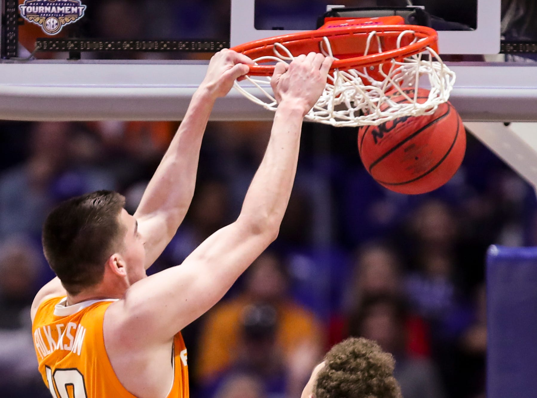 Tennessee forward John Fulkerson (10) dunks over Kentucky forward Reid Travis (22) during the second half of the SEC Men's Basketball Tournament semifinal game at Bridgestone Arena in Nashville, Tenn., Saturday, March 16, 2019.