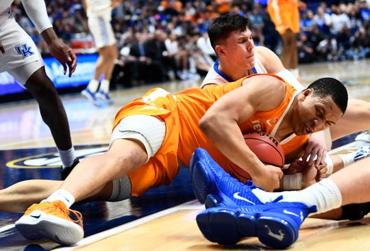 Tennessee forward Grant Williams (2) and Kentucky guard Tyler Herro (14) battle for a ball in the second half of the SEC Men's Basketball Tournament game at Bridgestone Arena in Nashville, Tenn., Saturday, March 16, 2019.