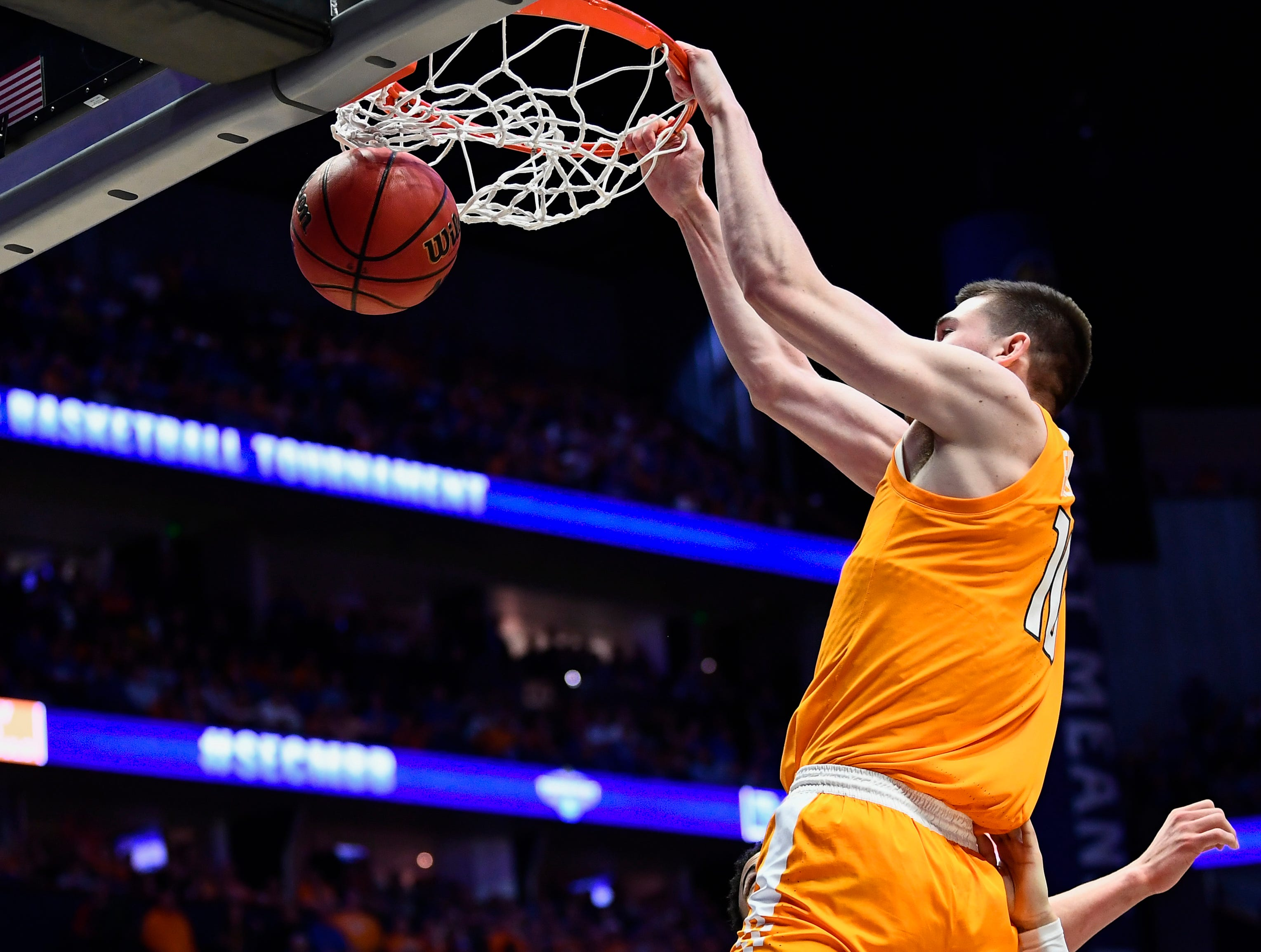 Tennessee forward John Fulkerson (10) dunks against Kentucky during the second half of the SEC Men's Basketball Tournament semifinal game at Bridgestone Arena in Nashville, Tenn., Saturday, March 16, 2019.
