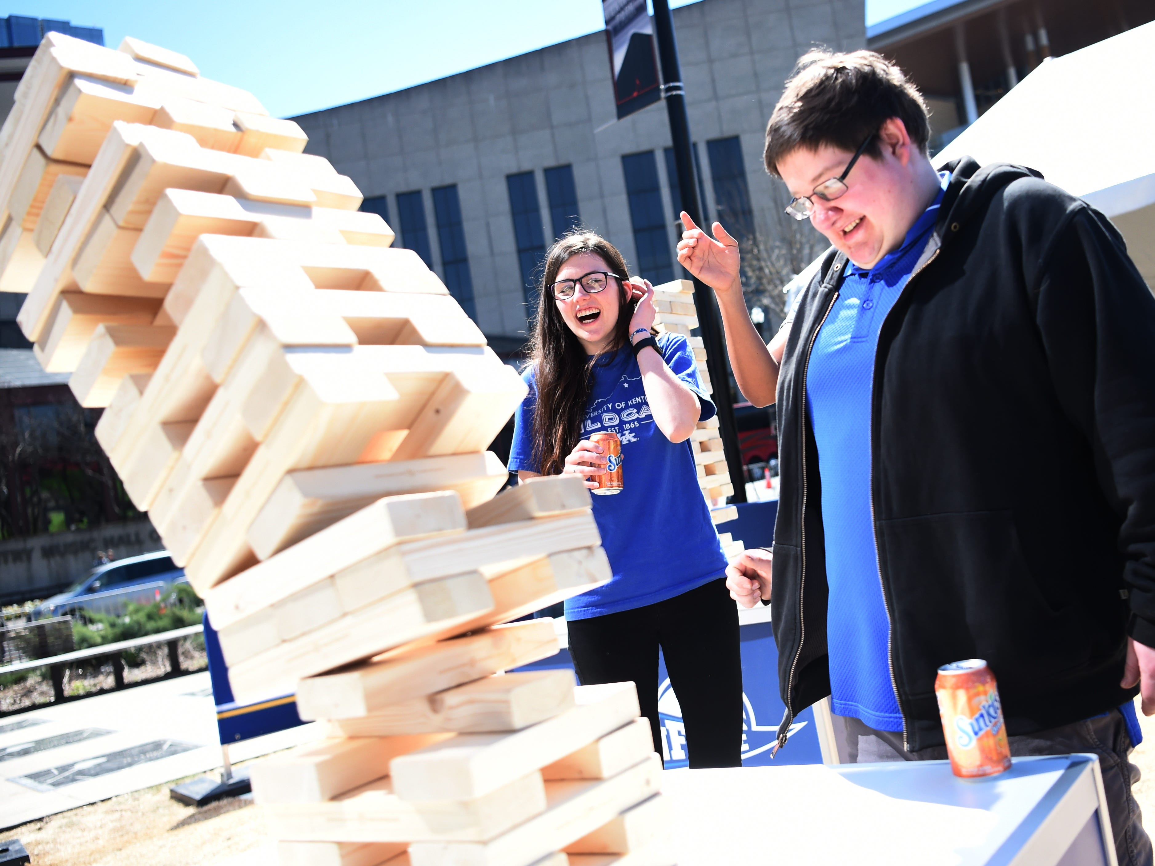 Kentucky students Stephanie Brown and Joe Willis play Jenga before the SEC Men's Basketball Tournament game against Tennessee at Bridgestone Arena in Nashville, Tenn., Saturday, March 16, 2019.