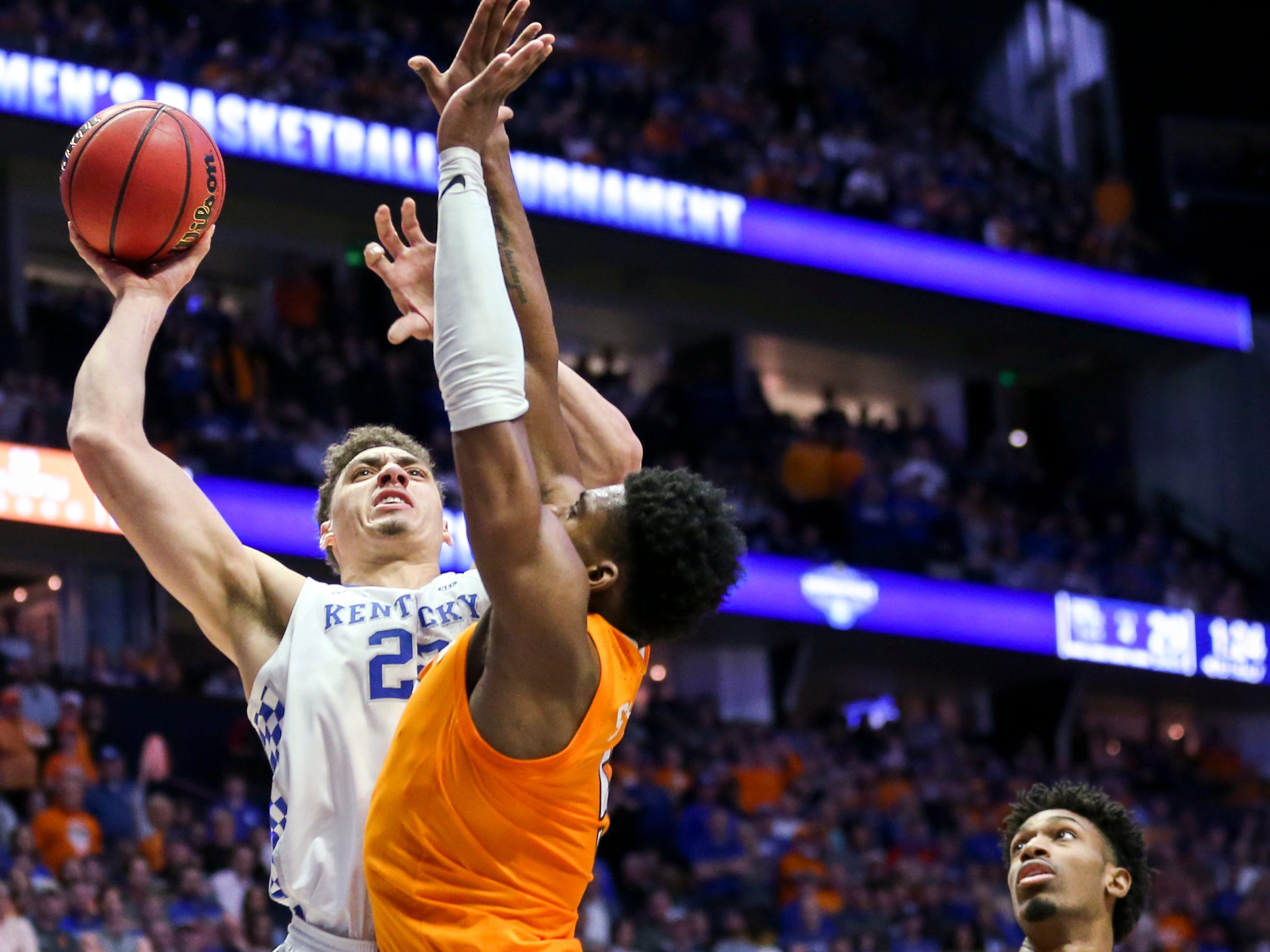 Kentucky forward Reid Travis (22) shoots over Tennessee guard Admiral Schofield (5) during the first half of the SEC Men's Basketball Tournament semifinal game at Bridgestone Arena in Nashville, Tenn., Saturday, March 16, 2019.