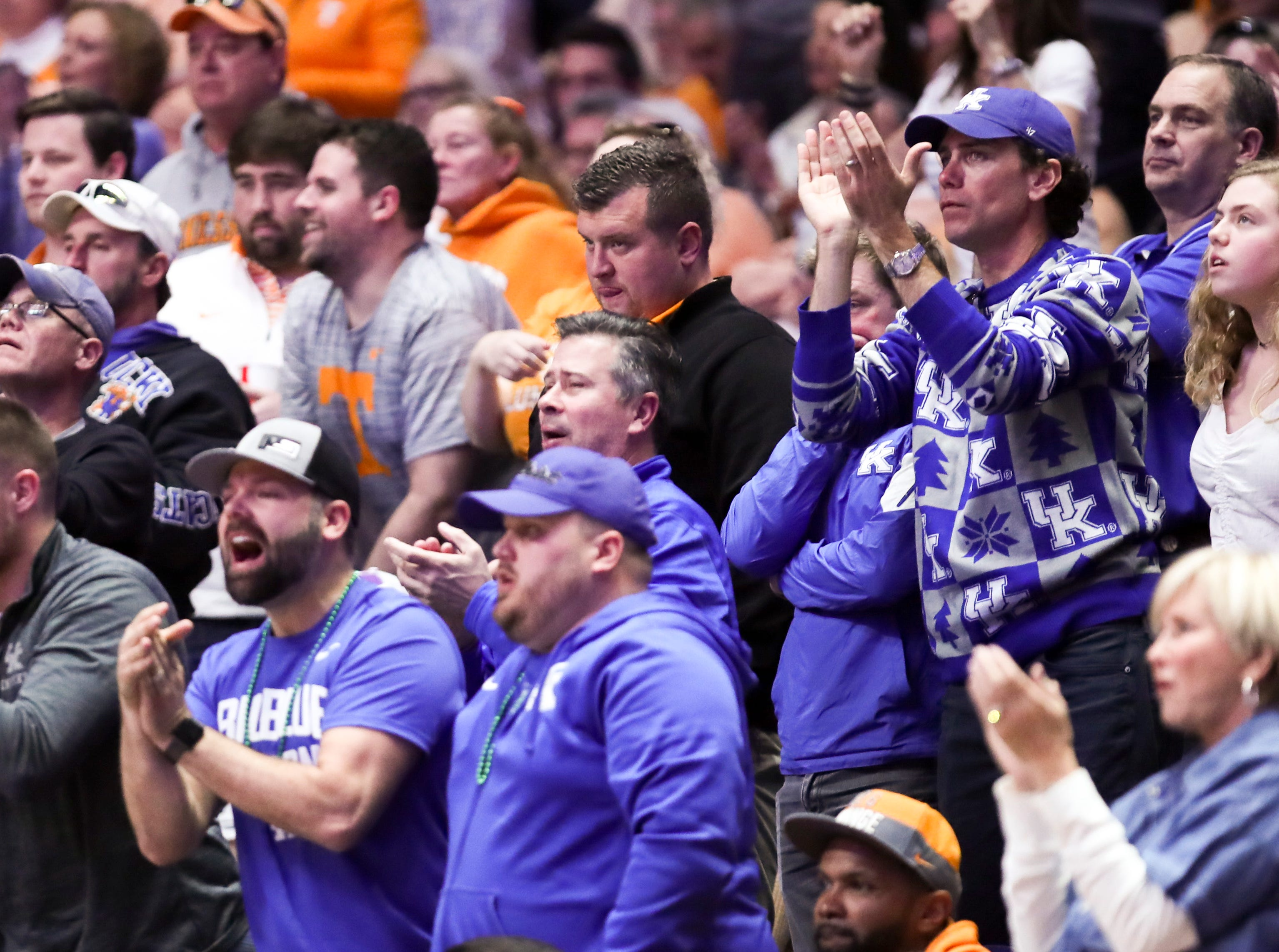 Kentucky fans cheer against Tennessee during the first half of the SEC Men's Basketball Tournament semifinal game at Bridgestone Arena in Nashville, Tenn., Saturday, March 16, 2019.