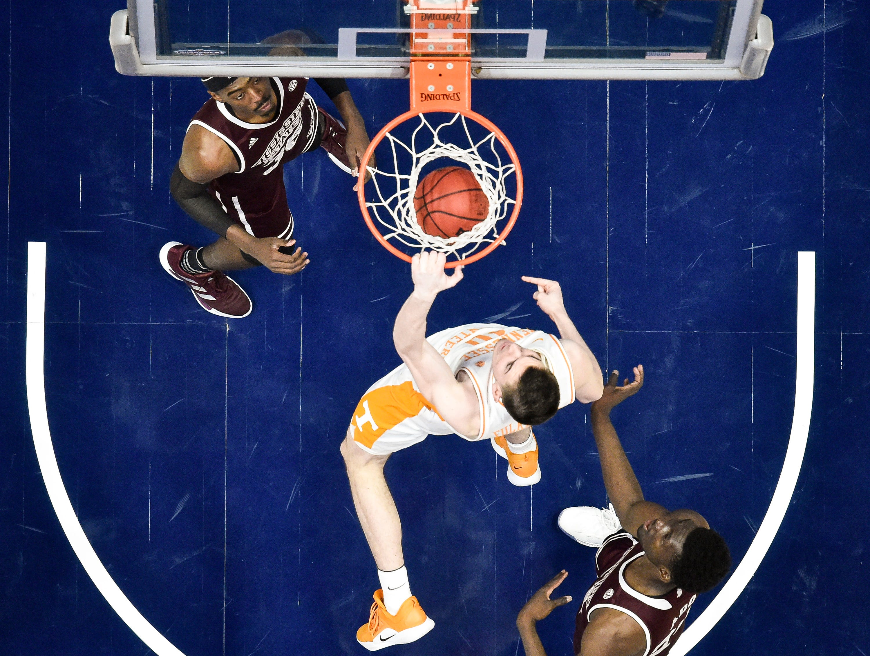 Tennessee forward John Fulkerson (10) dunks against Mississippi State during the first half of the SEC Men's Basketball Tournament game at Bridgestone Arena in Nashville, Tenn., Friday, March 15, 2019.