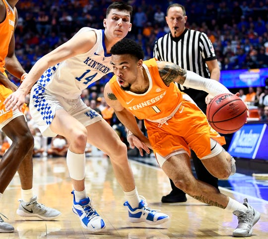 Tennessee guard Lamonte Turner (1) works past Kentucky guard Tyler Herro (14) during the first half of the SEC Men's Basketball Tournament semifinal game at Bridgestone Arena in Nashville, Tenn., Saturday, March 16, 2019.