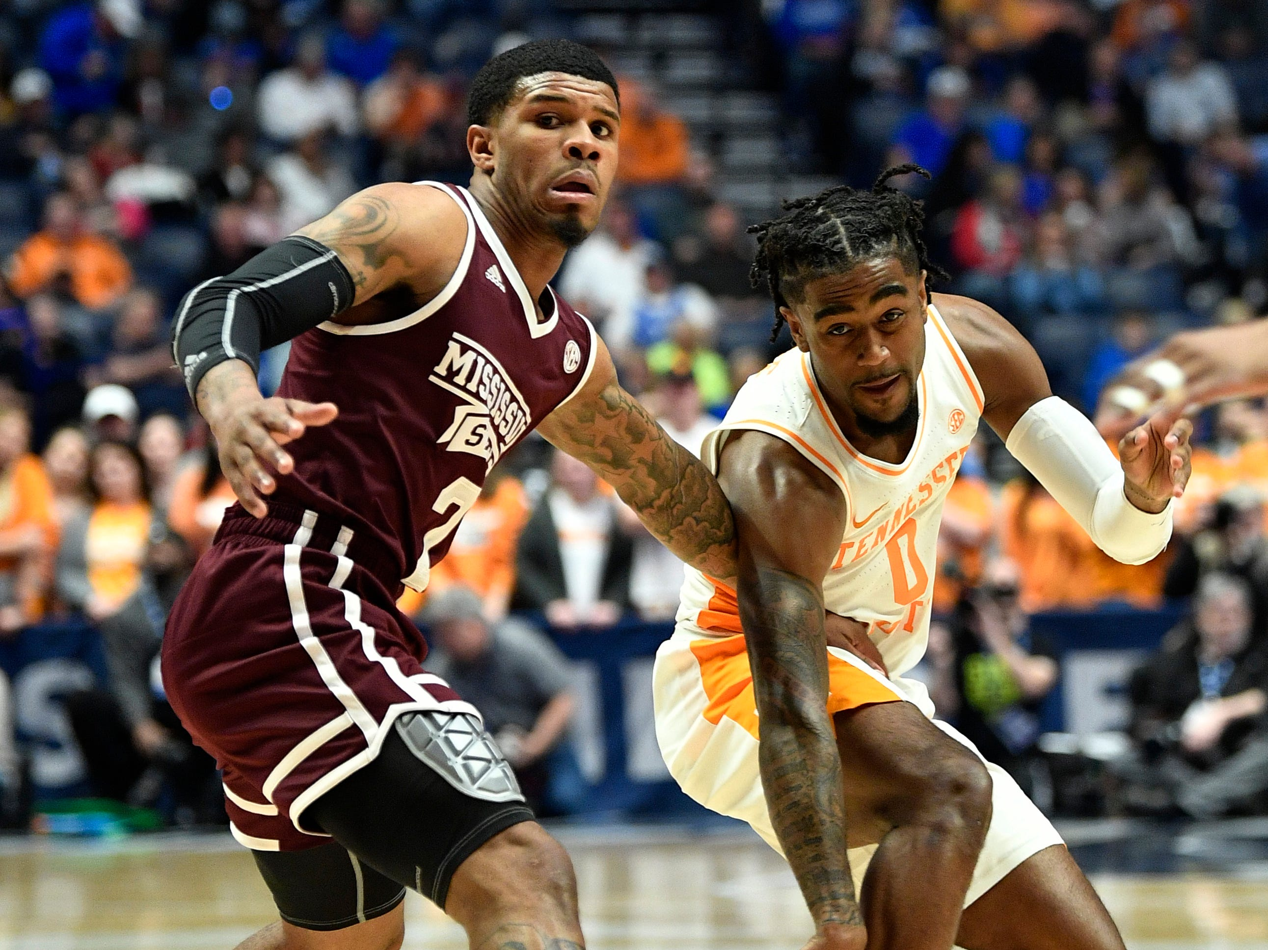 Mississippi State guard Lamar Peters (2) and Tennessee guard Jordan Bone (0) go after a loose ball during the first half of the SEC Men's Basketball Tournament game at Bridgestone Arena in Nashville, Tenn., Friday, March 15, 2019.