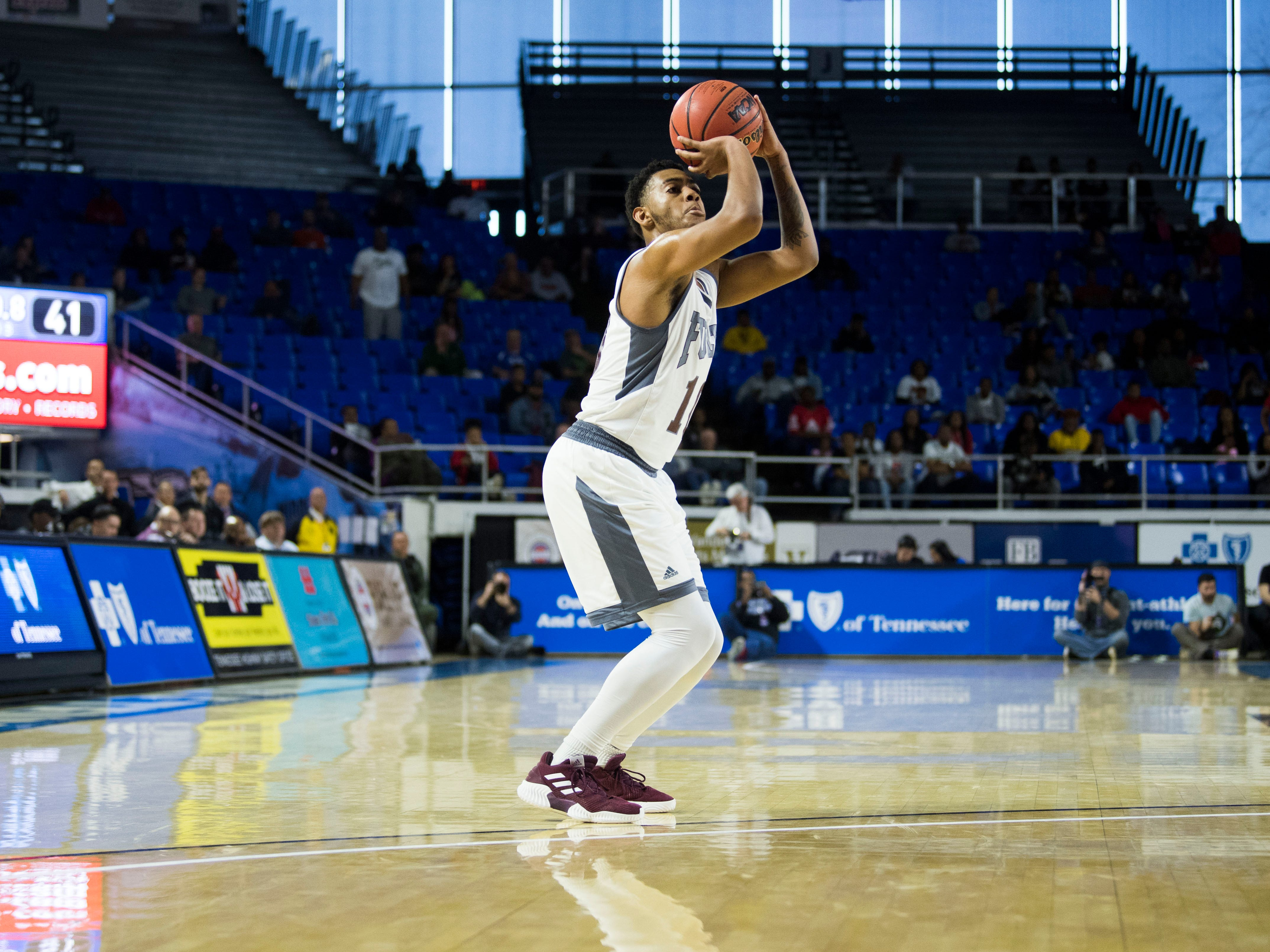 Fulton's Trey West (10) takes a three-point shot during a TSSAA AA state championship game between Wooddale and Fulton at the Murphy Center in Murfreesboro, Saturday, March 16, 2019.