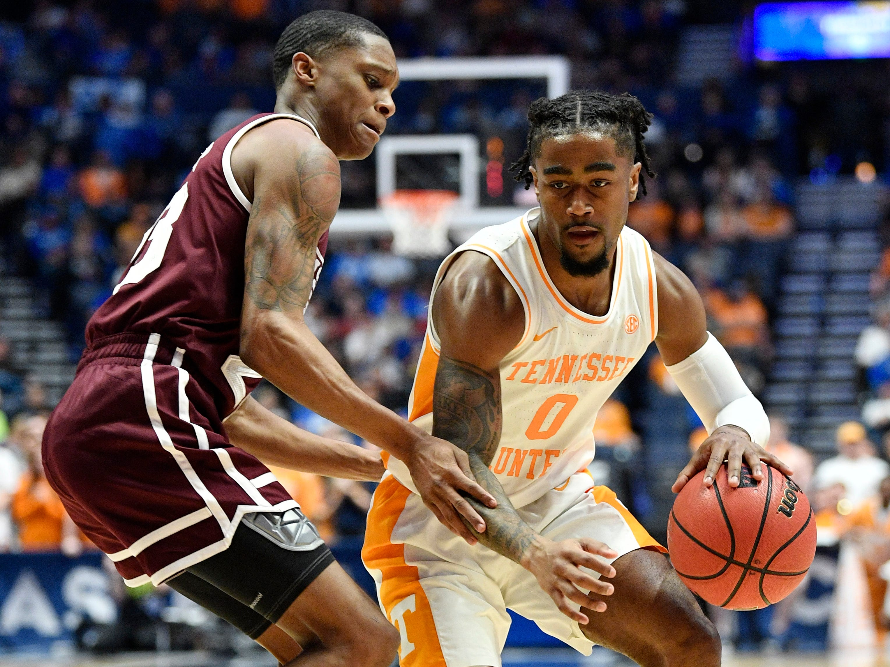 Tennessee guard Jordan Bone (0) moves the ball defended by Mississippi State guard Tyson Carter (23) during the first half of the SEC Men's Basketball Tournament game at Bridgestone Arena in Nashville, Tenn., Friday, March 15, 2019.