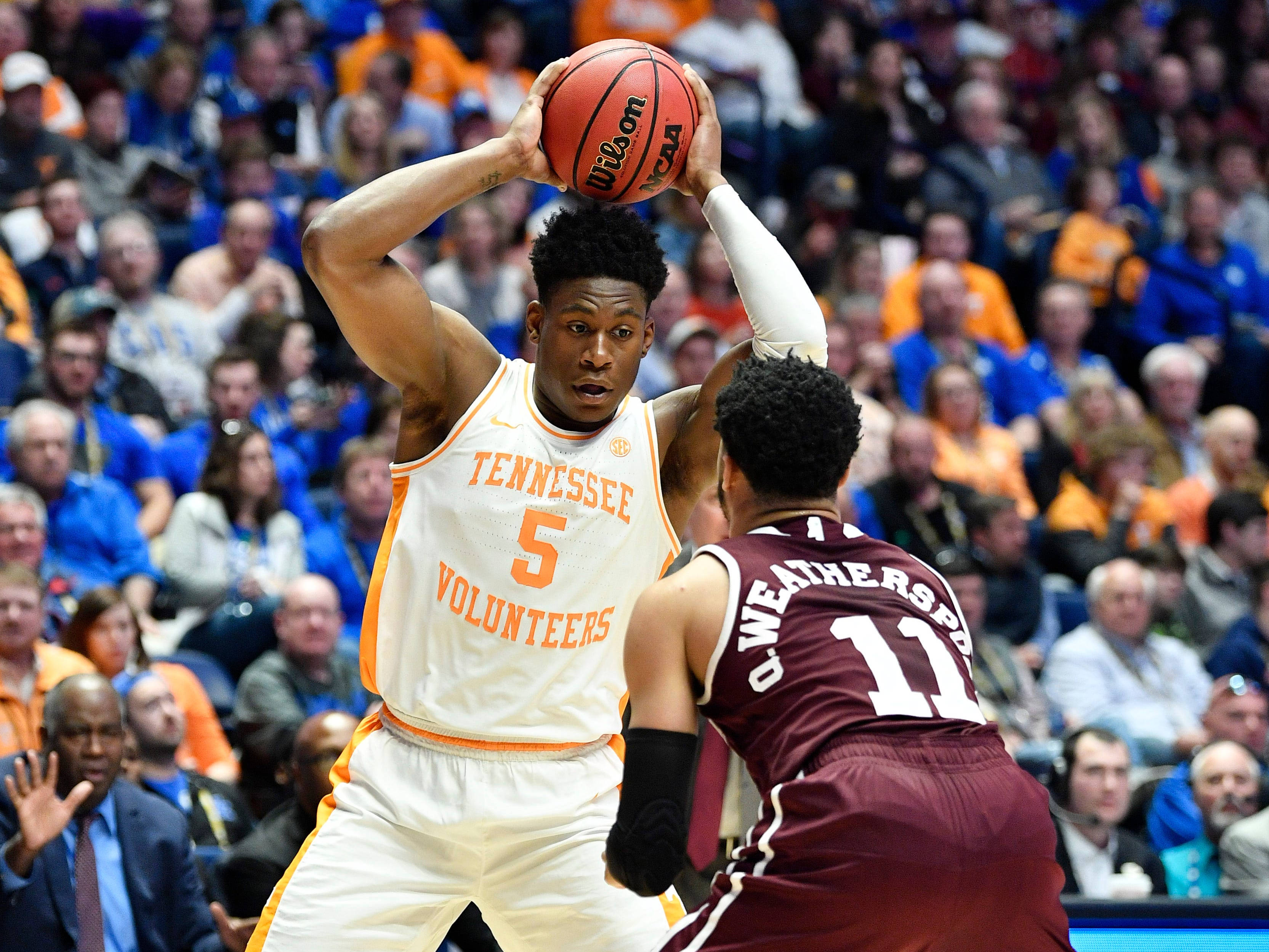 Tennessee guard Admiral Schofield (5) tries to move the ball defended by Mississippi State guard Quinndary Weatherspoon (11) during the first half of the SEC Men's Basketball Tournament game at Bridgestone Arena in Nashville, Tenn., Friday, March 15, 2019.