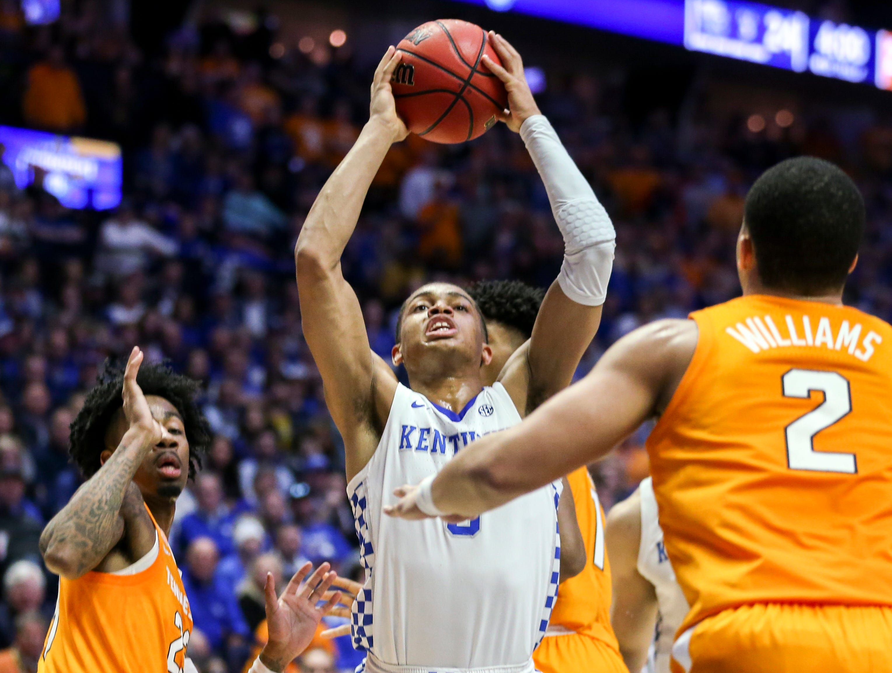 Kentucky guard Keldon Johnson (3) looks for an opening against Tennessee during the first half of the SEC Men's Basketball Tournament semifinal game at Bridgestone Arena in Nashville, Tenn., Saturday, March 16, 2019.