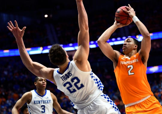 Tennessee forward Grant Williams (2) goes up for a shot defended by Kentucky forward Reid Travis (22) during the second half of the SEC Men's Basketball Tournament game at Bridgestone Arena in Nashville, Tenn., Saturday, March 16, 2019.