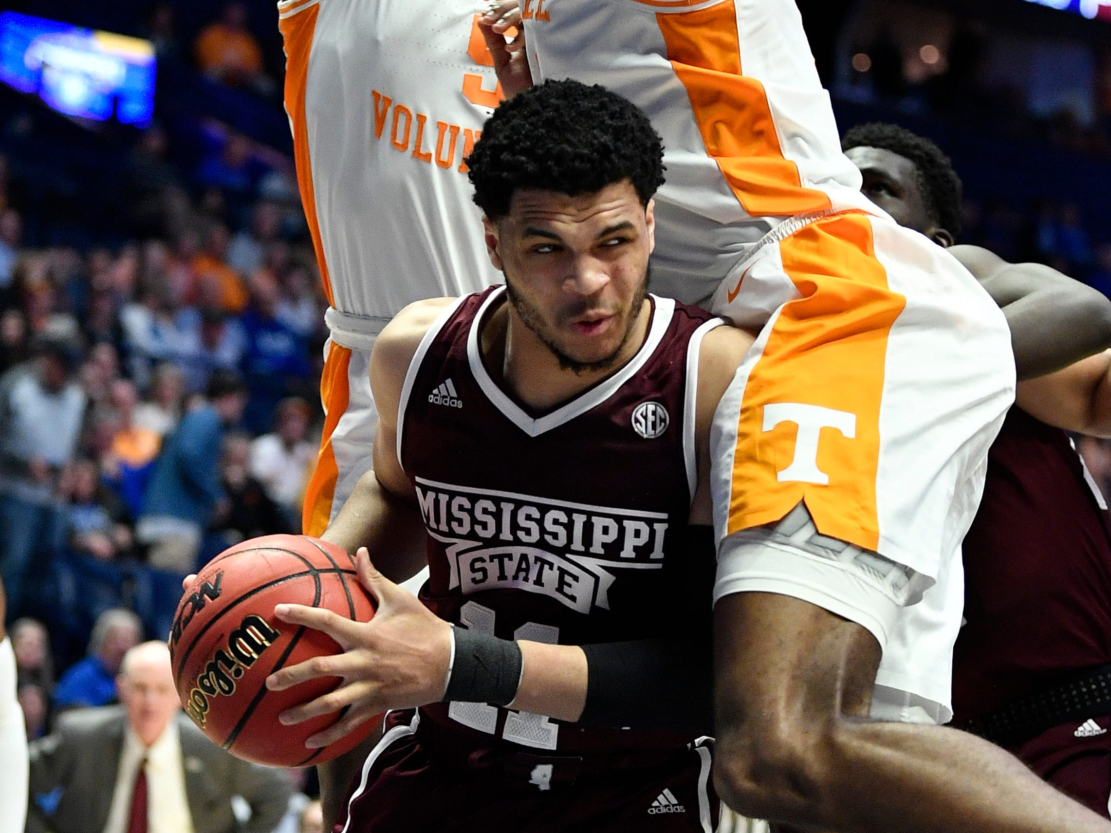 Mississippi State guard Quinndary Weatherspoon (11) gets sandwiched by Tennessee defenders during the second half of the SEC Men's Basketball Tournament game at Bridgestone Arena in Nashville, Tenn., Friday, March 15, 2019.