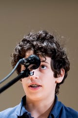 Owen Davis spells out a word at the News Sentinel Southern Appalachia Regional Spelling Bee at Alumni Memorial Hall in Knoxville, Tennessee on Saturday, March 16, 2019.