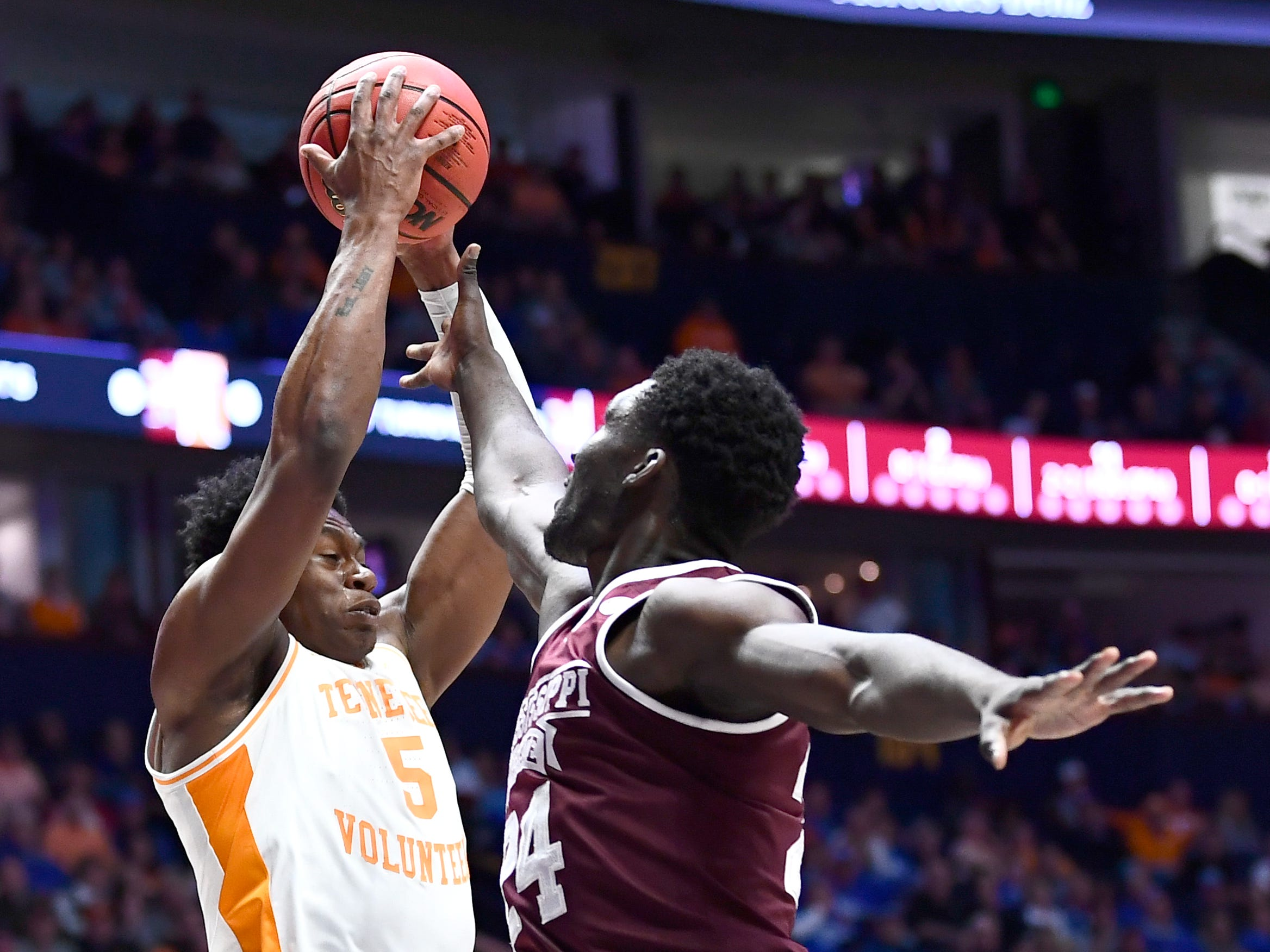 Tennessee guard Admiral Schofield (5) grabs a rebound in front of Mississippi State forward Abdul Ado (24) during the first half of the SEC Men's Basketball Tournament game at Bridgestone Arena in Nashville, Tenn., Friday, March 15, 2019.