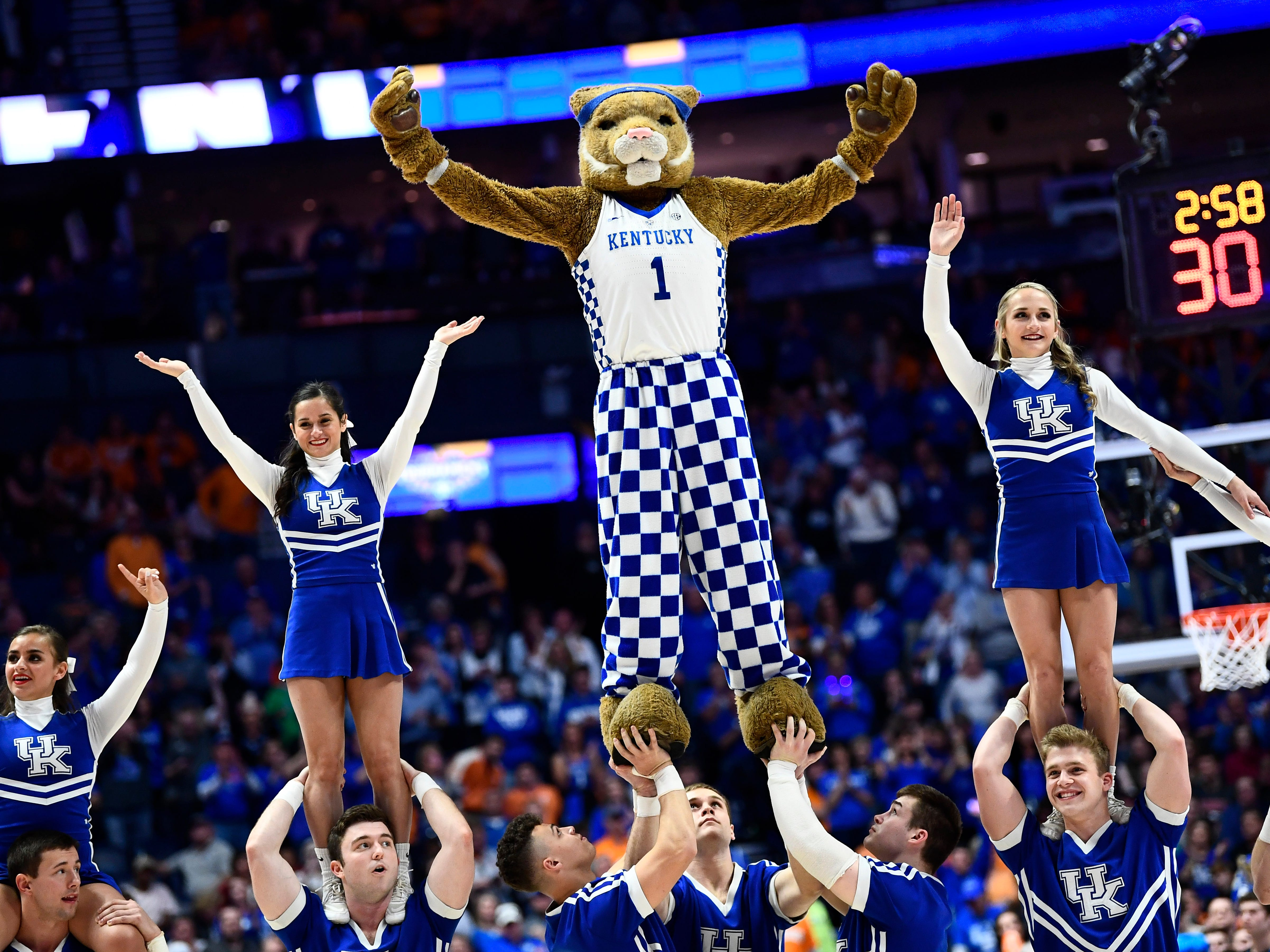 Kentucky cheerleaders lead the fans during the second half of the SEC Men's Basketball Tournament game against Tennessee at Bridgestone Arena in Nashville, Tenn., Saturday, March 16, 2019.