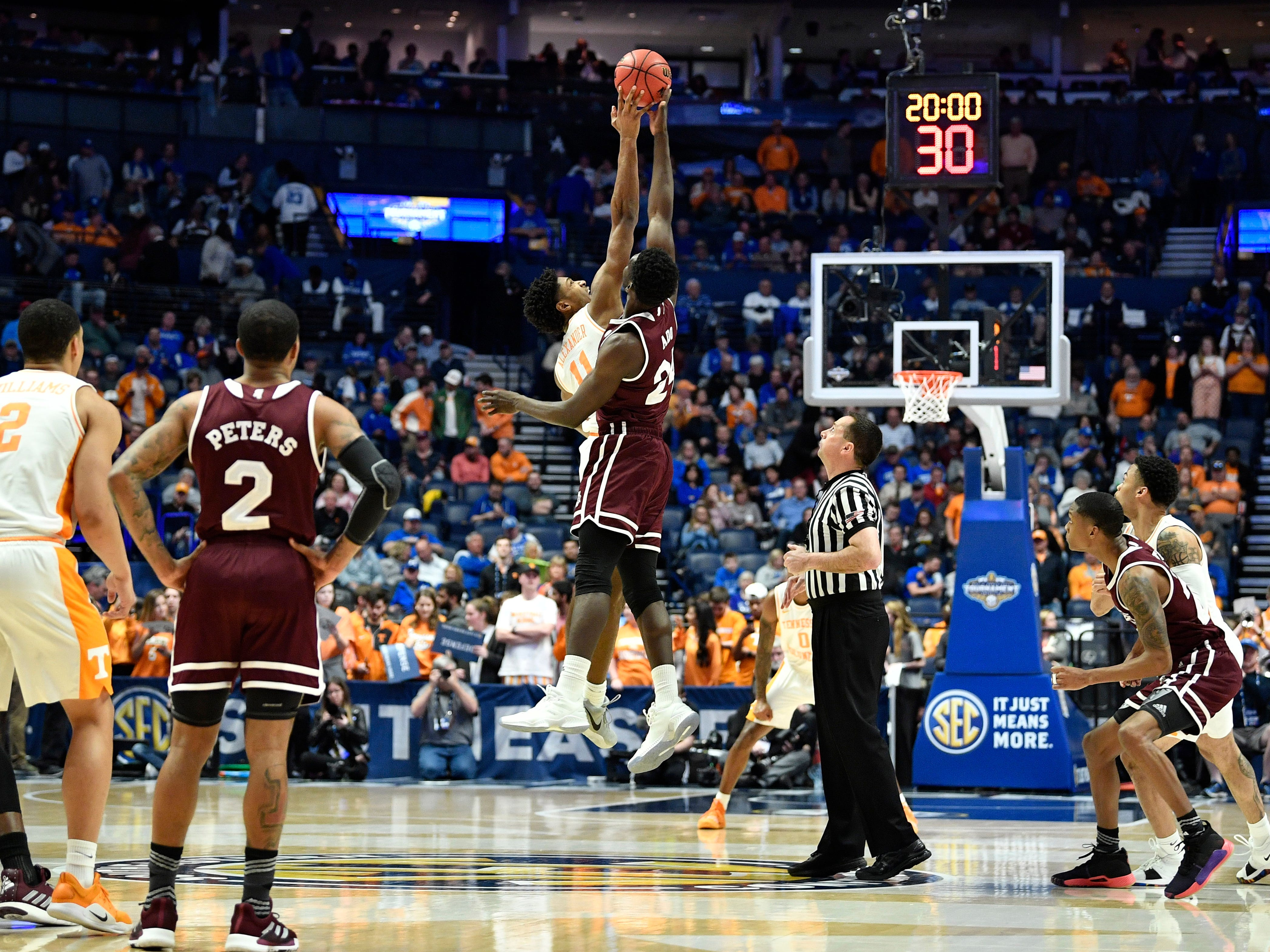 Tennessee forward Kyle Alexander (11) and Mississippi State forward Abdul Ado (24) go up for the opening tipoff at  their SEC Men's Basketball Tournament game at Bridgestone Arena in Nashville, Tenn., Friday, March 15, 2019.