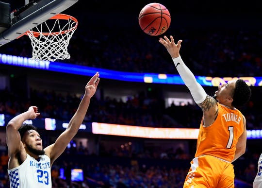 Tennessee guard Lamonte Turner (1) shoots over Kentucky forward EJ Montgomery (23) during the first half of the SEC Men's Basketball Tournament semifinal game at Bridgestone Arena in Nashville, Tenn., Saturday, March 16, 2019.