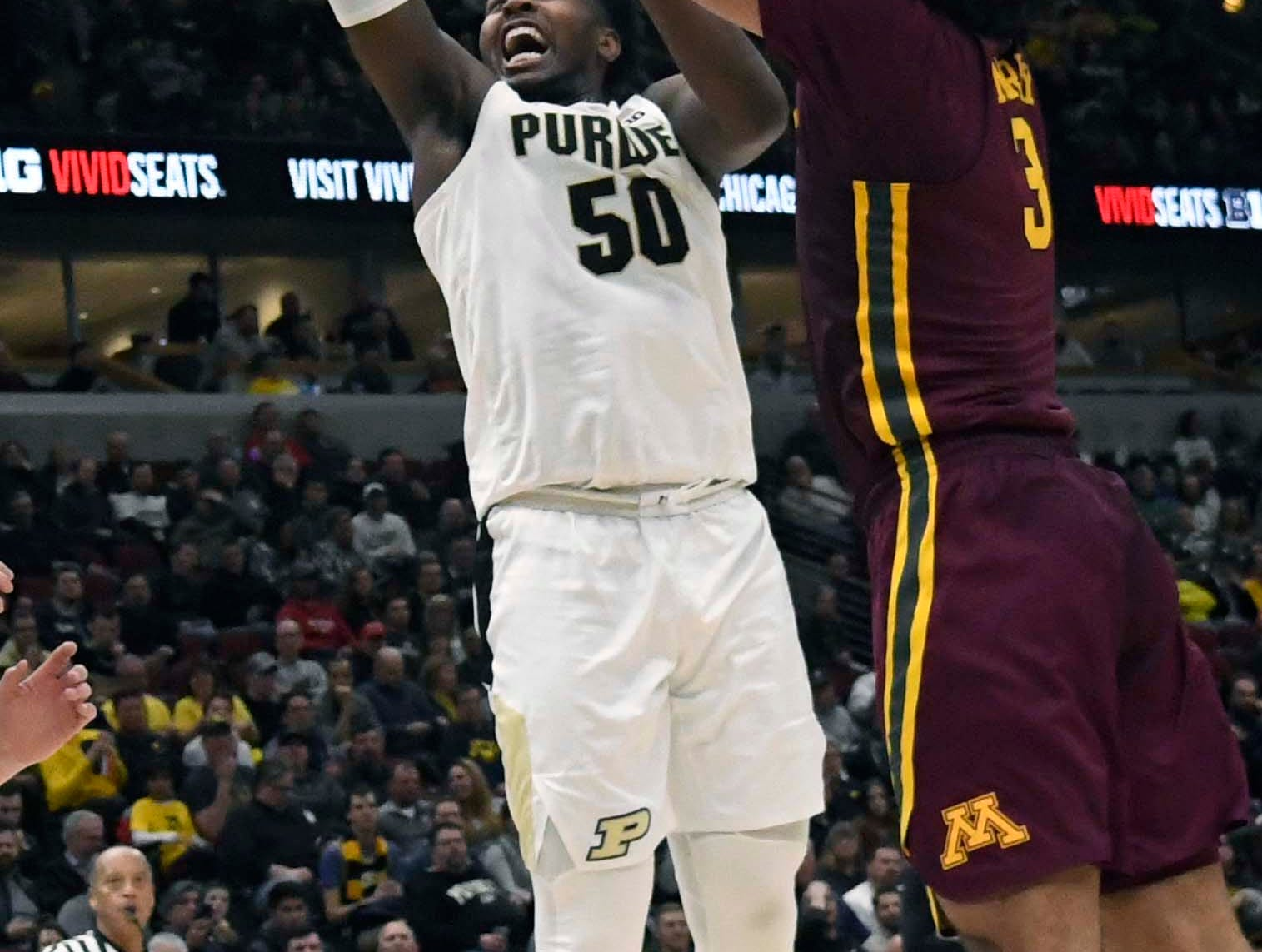 Mar 15, 2019; Chicago, IL, USA; Purdue Boilermakers forward Trevion Williams (50) shoots the ball as Minnesota Golden Gophers forward Jordan Murphy (3)defends him during the second half in the Big Ten conference tournament at United Center. Mandatory Credit: David Banks-USA TODAY Sports