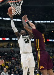 Purdue Boilermakers forward Trevion Williams (50) shoots the ball as Minnesota Golden Gophers forward Jordan Murphy (3)defends him during the second half in the Big Ten conference tournament at United Center.