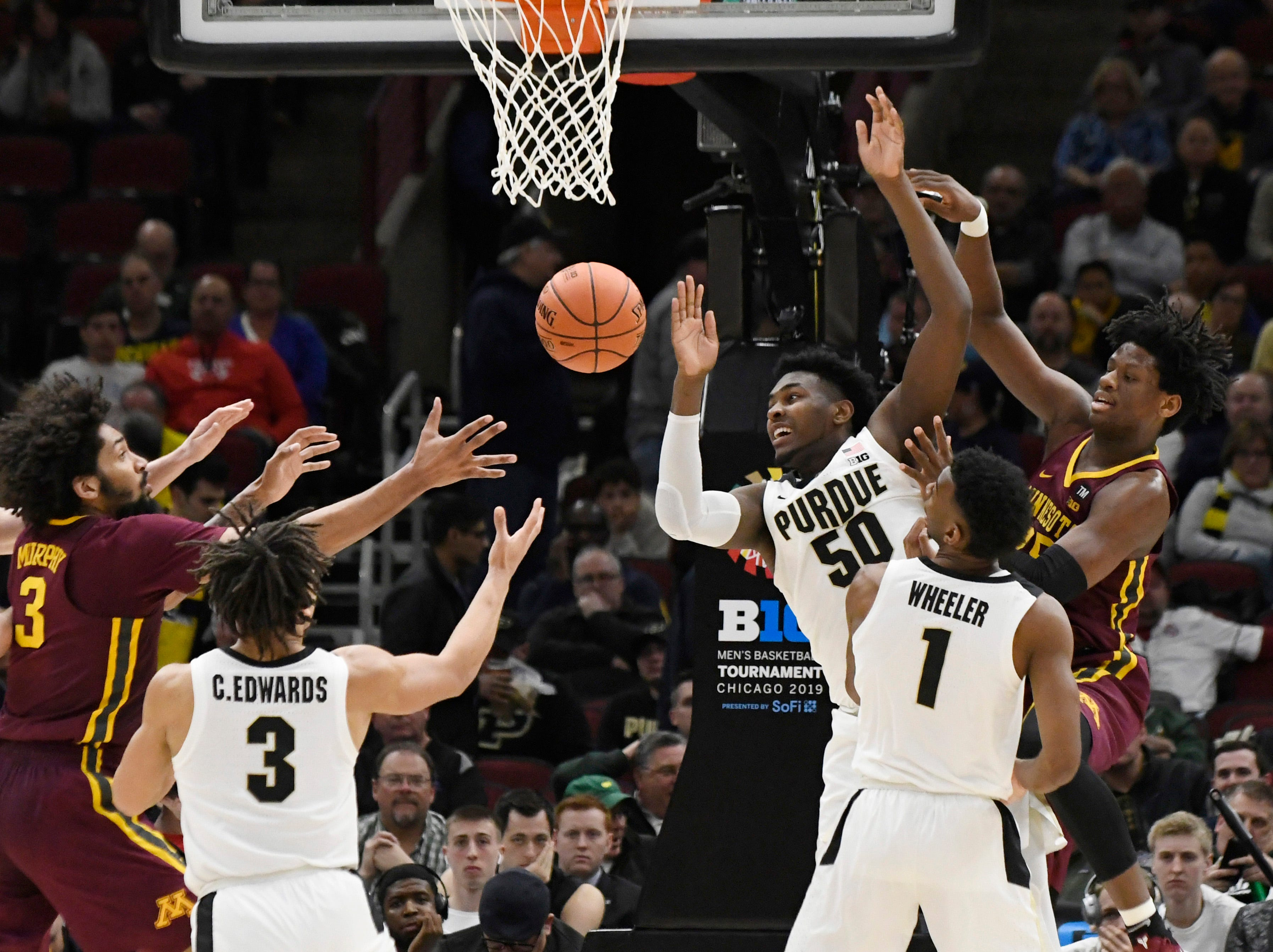Mar 15, 2019; Chicago, IL, USA; Purdue Boilermakers forward Trevion Williams (50)  jumps for a rebound against the Minnesota Golden Gophers during the second half in the Big Ten conference tournament at United Center. Mandatory Credit: David Banks-USA TODAY Sports
