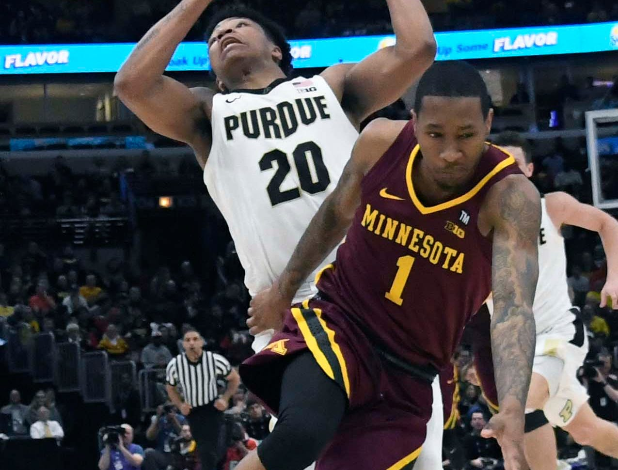 Mar 15, 2019; Chicago, IL, USA; Purdue Boilermakers guard Carsen Edwards (3) is defended by Minnesota Golden Gophers guard Dupree McBrayer (1) during the second half in the Big Ten conference tournament at United Center. Mandatory Credit: David Banks-USA TODAY Sports