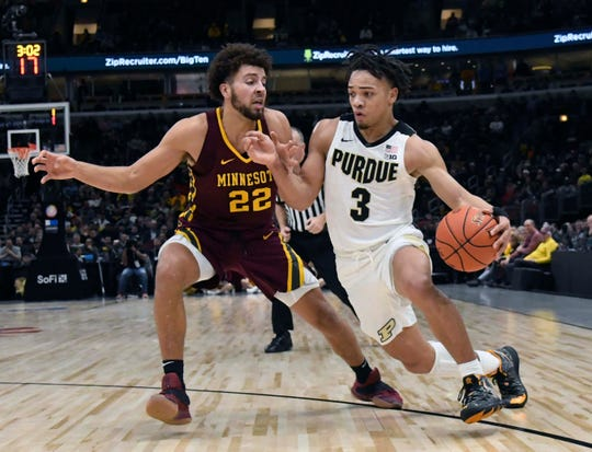 Mar 15, 2019; Chicago, IL, USA; Purdue Boilermakers guard Carsen Edwards (3) drives to the basket as Minnesota Golden Gophers guard Gabe Kalscheur (22) defends him during the second half in the Big Ten conference tournament at United Center. Mandatory Credit: David Banks-USA TODAY Sports