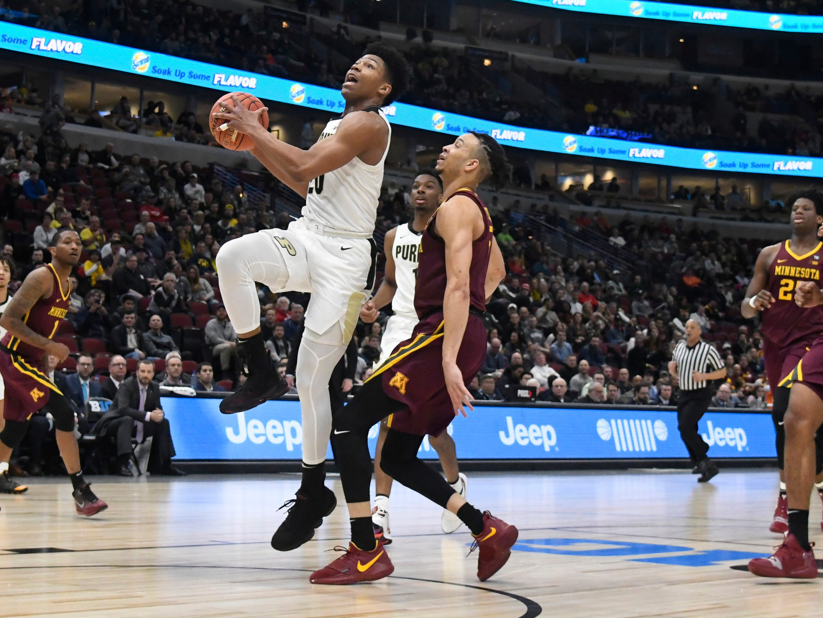 Mar 15, 2019; Chicago, IL, USA; Purdue Boilermakers guard Nojel Eastern (20) drives to the basket against Minnesota Golden Gophers guard Amir Coffey (5) during the second half in the Big Ten conference tournament at United Center. Mandatory Credit: David Banks-USA TODAY Sports