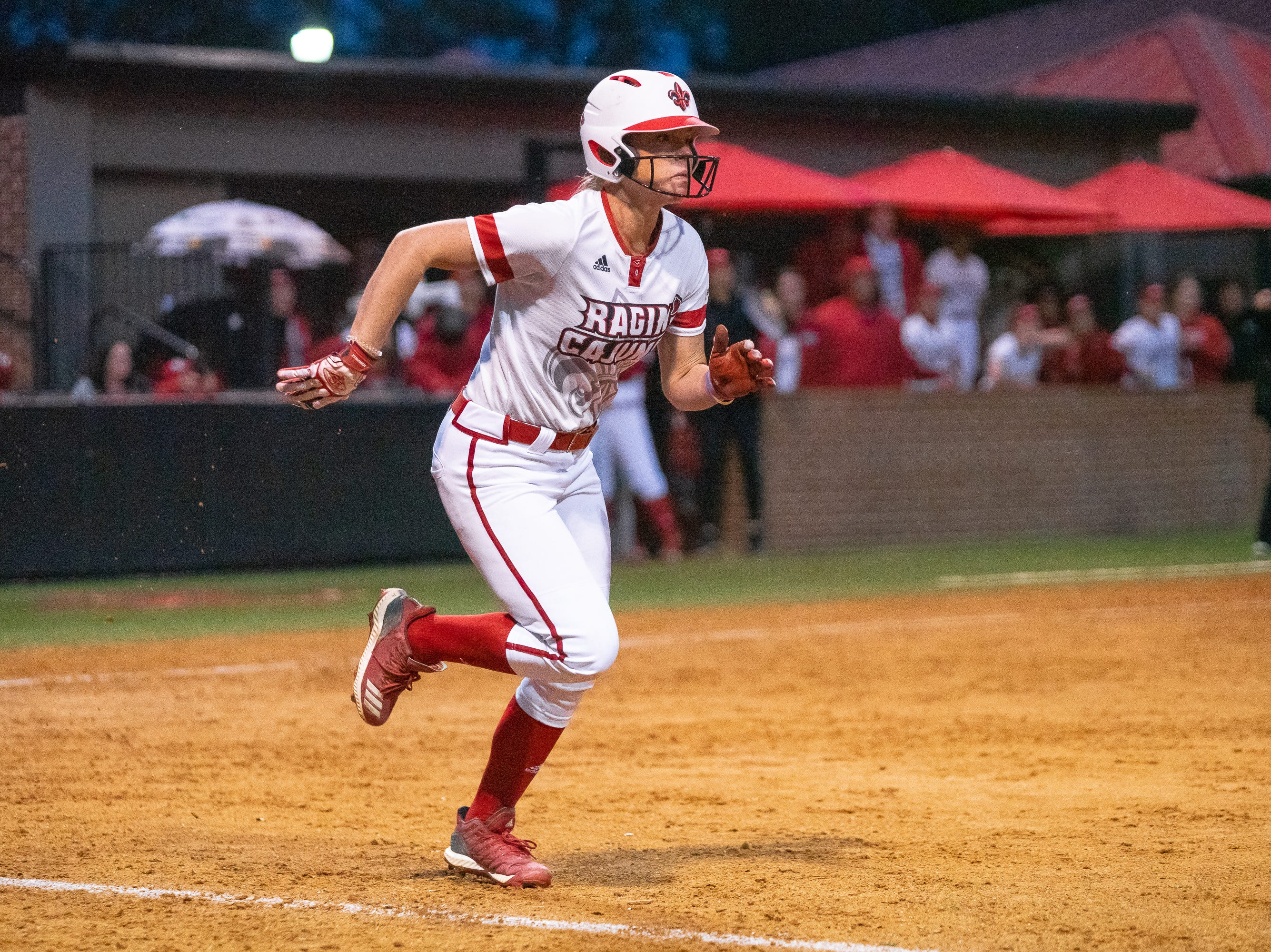 UL's Casidy Chaumont runs to first base as the Ragin' Cajuns take on the Troy Trojans at Lamson Park, Yvette Girouard Field on Friday, March 15, 2019.