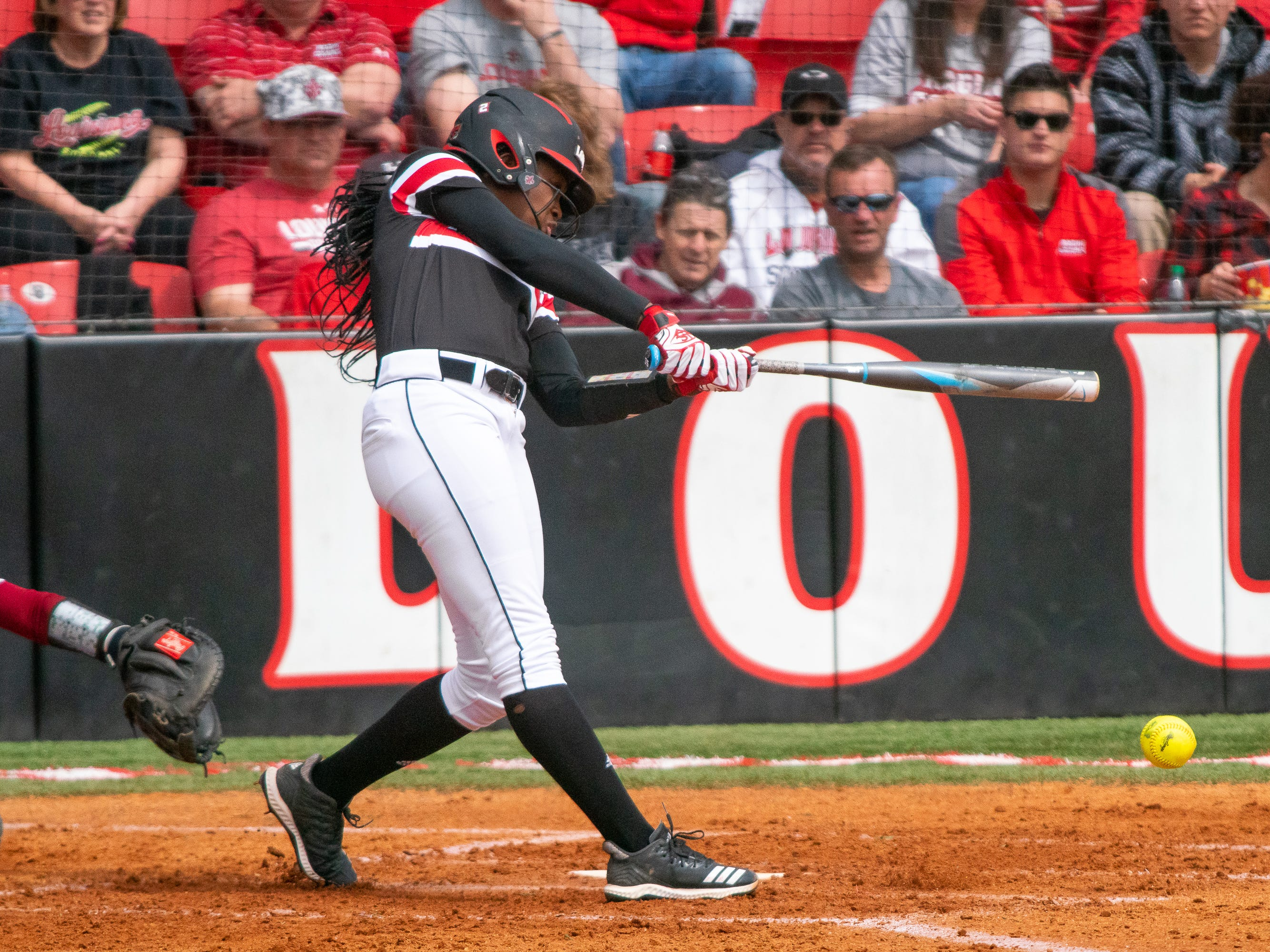 UL's Raina O'Neal hits a grounder as the Ragin' Cajuns take on the Troy Trojans at Yvette Girouard Field at Lamson Park on Saturday, March 16, 2019.