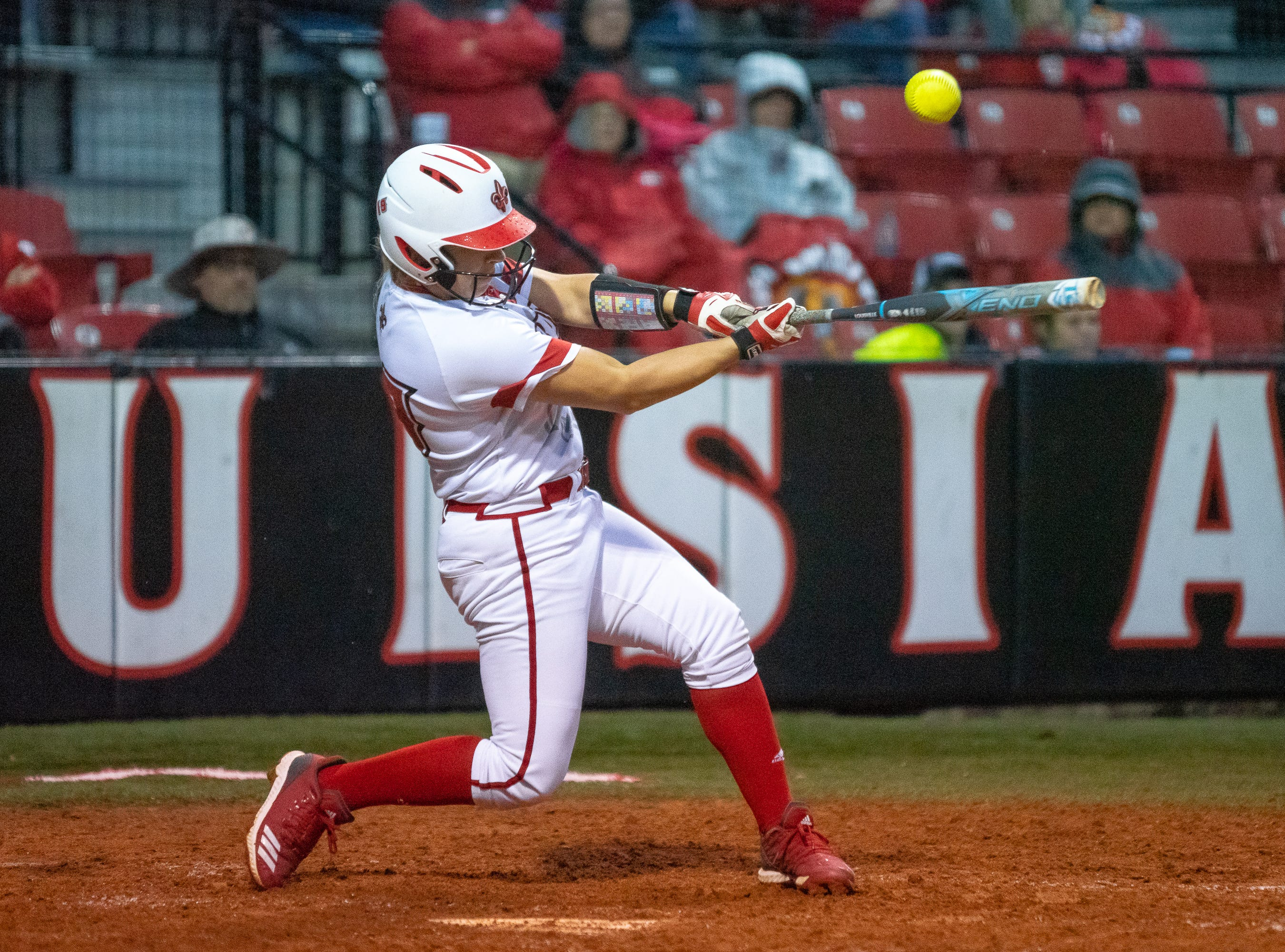 UL's Lexie Comeaux makes contact with the pitch as the Ragin' Cajuns take on the Troy Trojans at Lamson Park, Yvette Girouard Field on Friday, March 15, 2019.