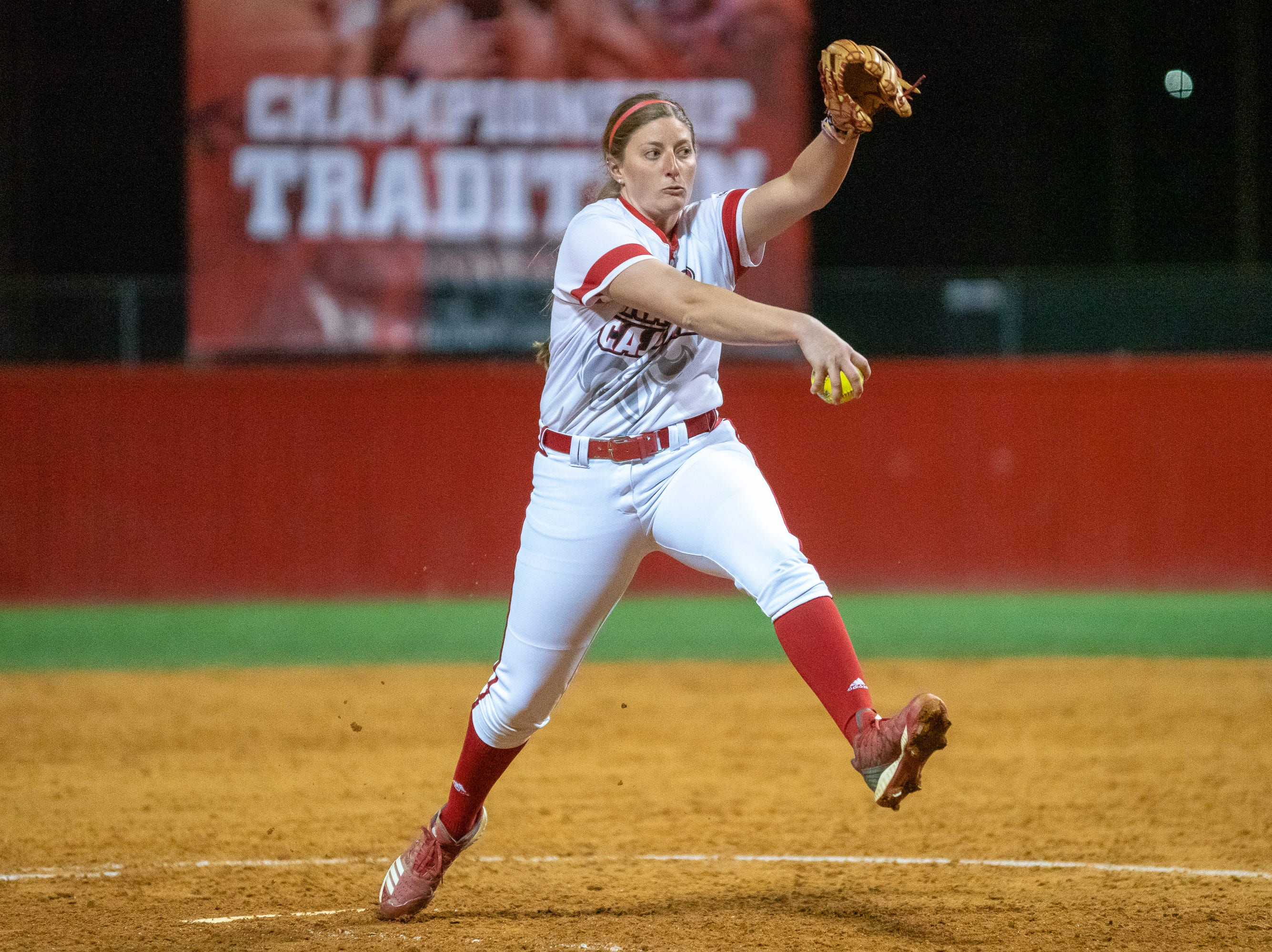 UL's Carrie Boswell pitches from the circle as the Ragin' Cajuns take on the Troy Trojans at Lamson Park, Yvette Girouard Field on Friday, March 15, 2019.