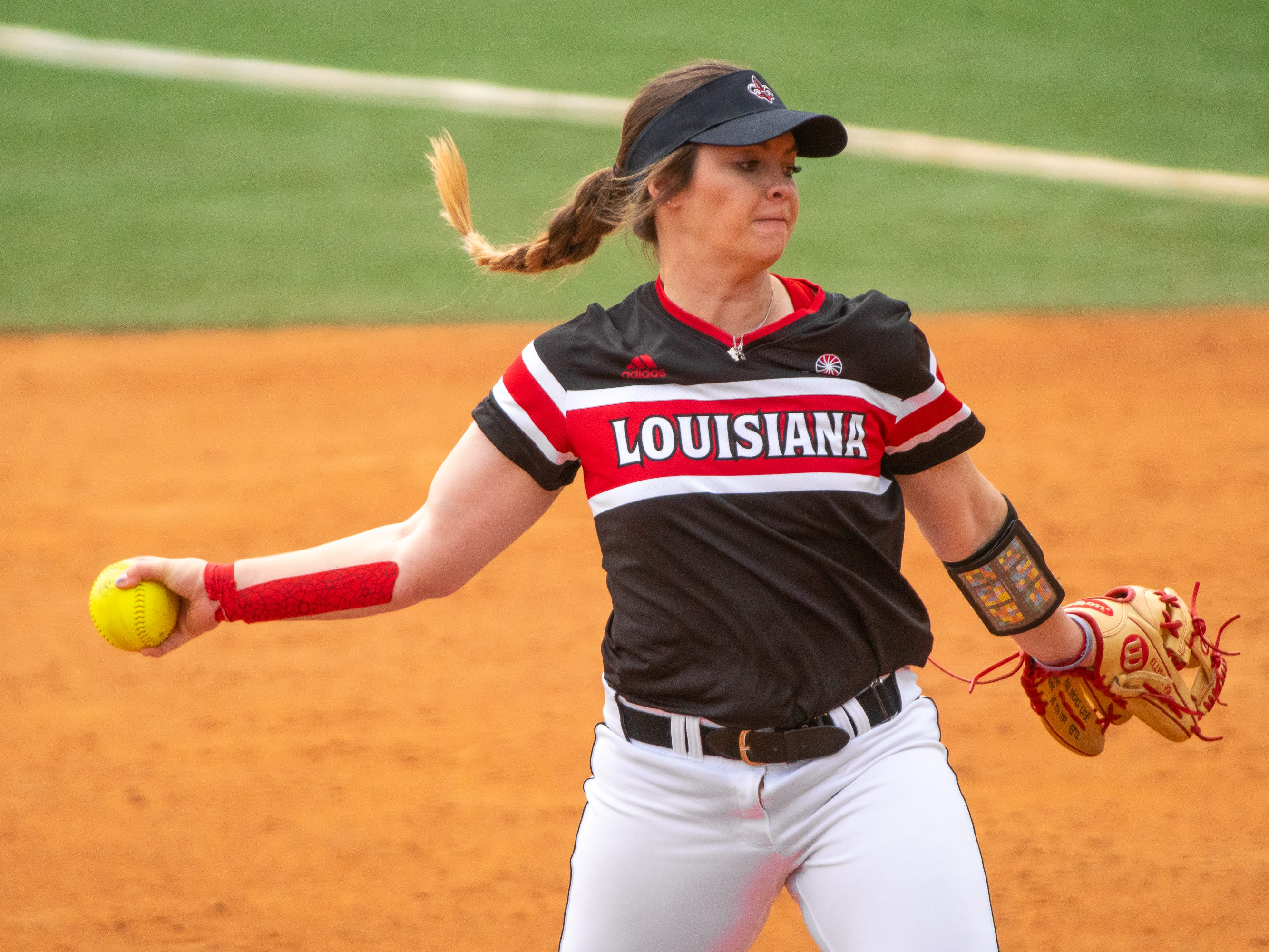 UL's pitcher Summer Ellyson throws the ball from the circle as the Ragin' Cajuns take on the Troy Trojans at Yvette Girouard Field at Lamson Park on Saturday, March 16, 2019.