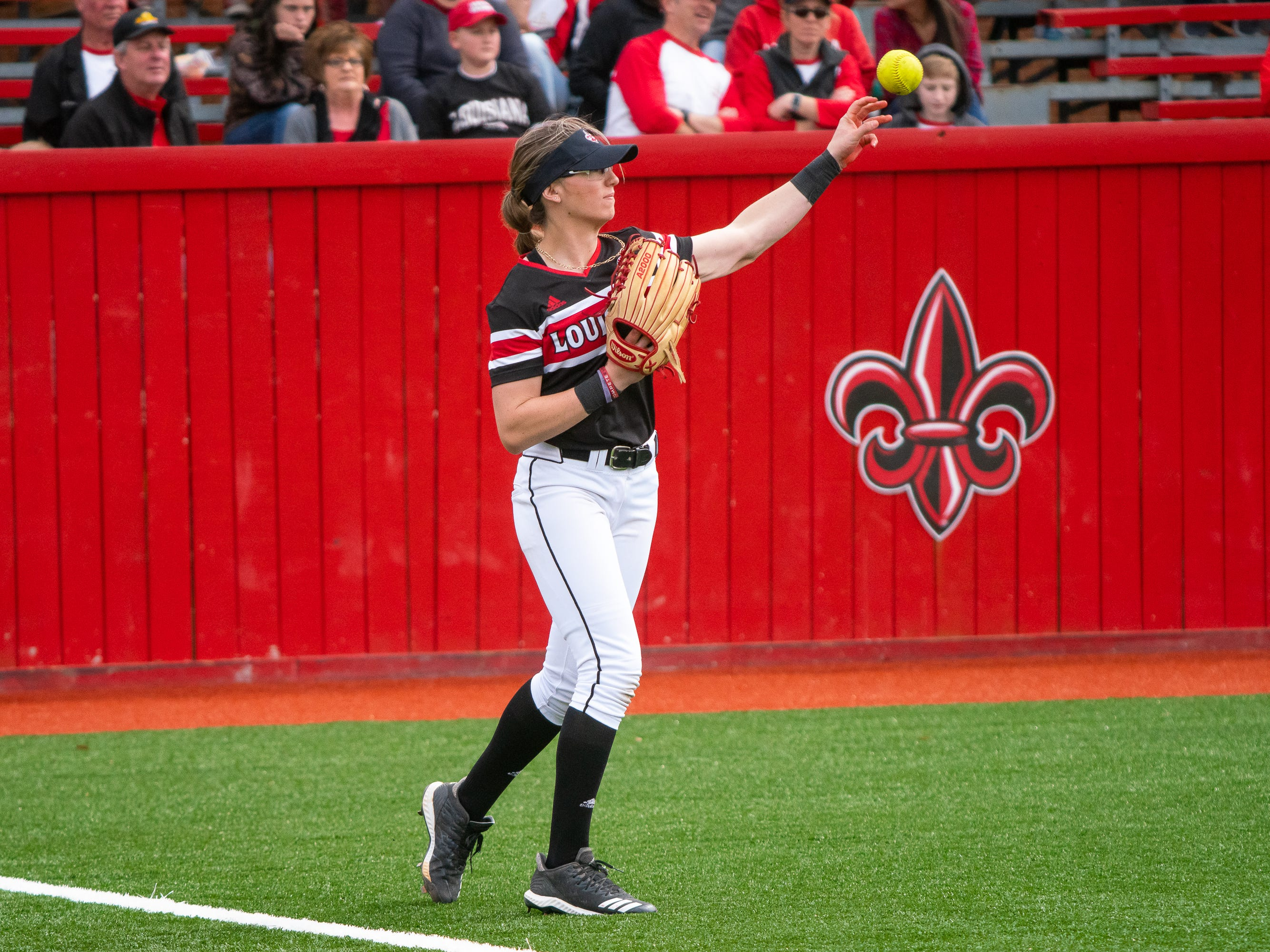 UL's Sarah Hudek throws the ball from the outfield as the Ragin' Cajuns take on the Troy Trojans at Yvette Girouard Field at Lamson Park on Saturday, March 16, 2019.