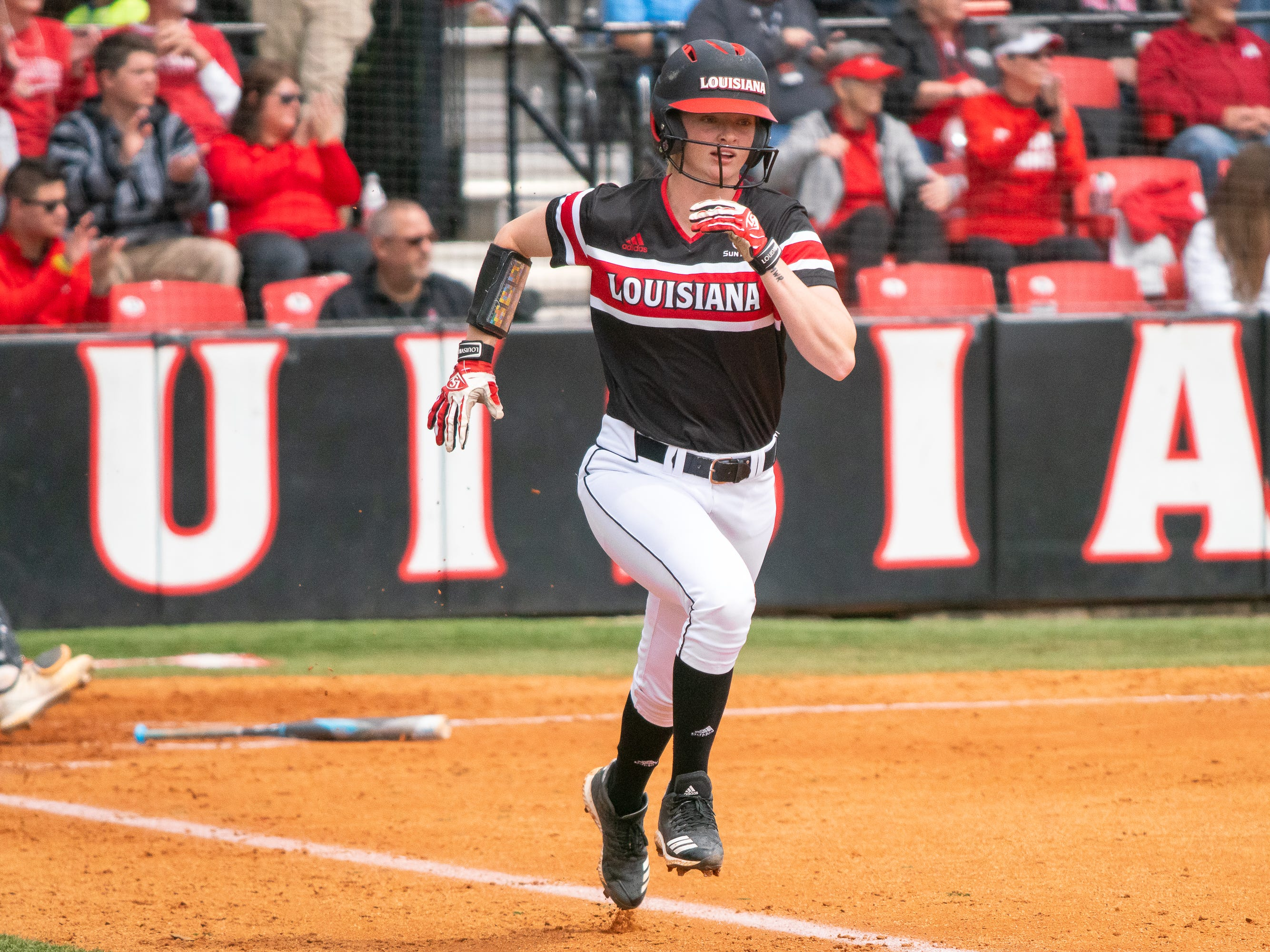 UL's Julie Rawls sprints to first base as the Ragin' Cajuns take on the Troy Trojans at Yvette Girouard Field at Lamson Park on Saturday, March 16, 2019.