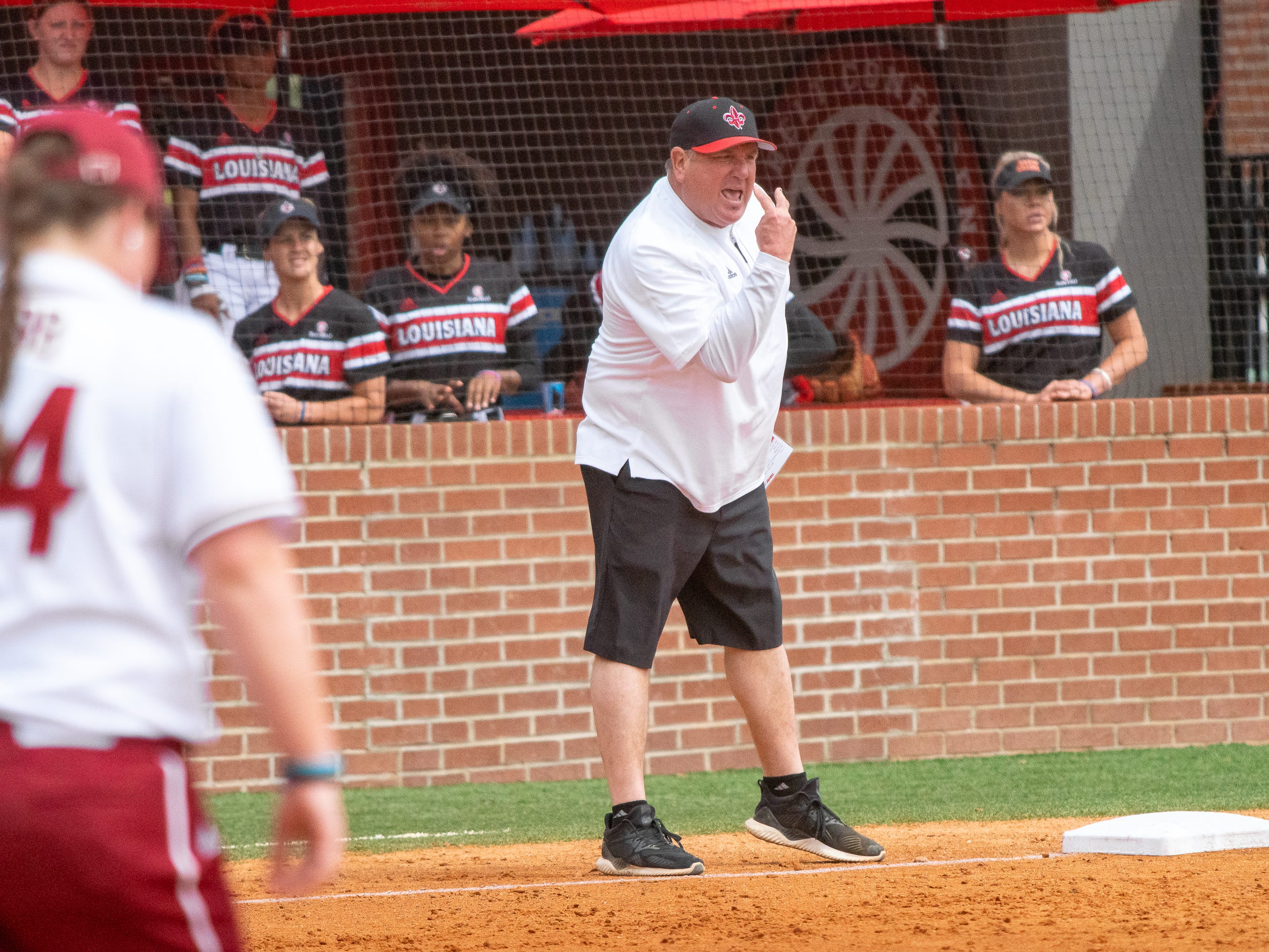 UL's head softball coach Gerry Glasco talks to his players from the sidelines as the Ragin' Cajuns take on the Troy Trojans at Yvette Girouard Field at Lamson Park on Saturday, March 16, 2019.