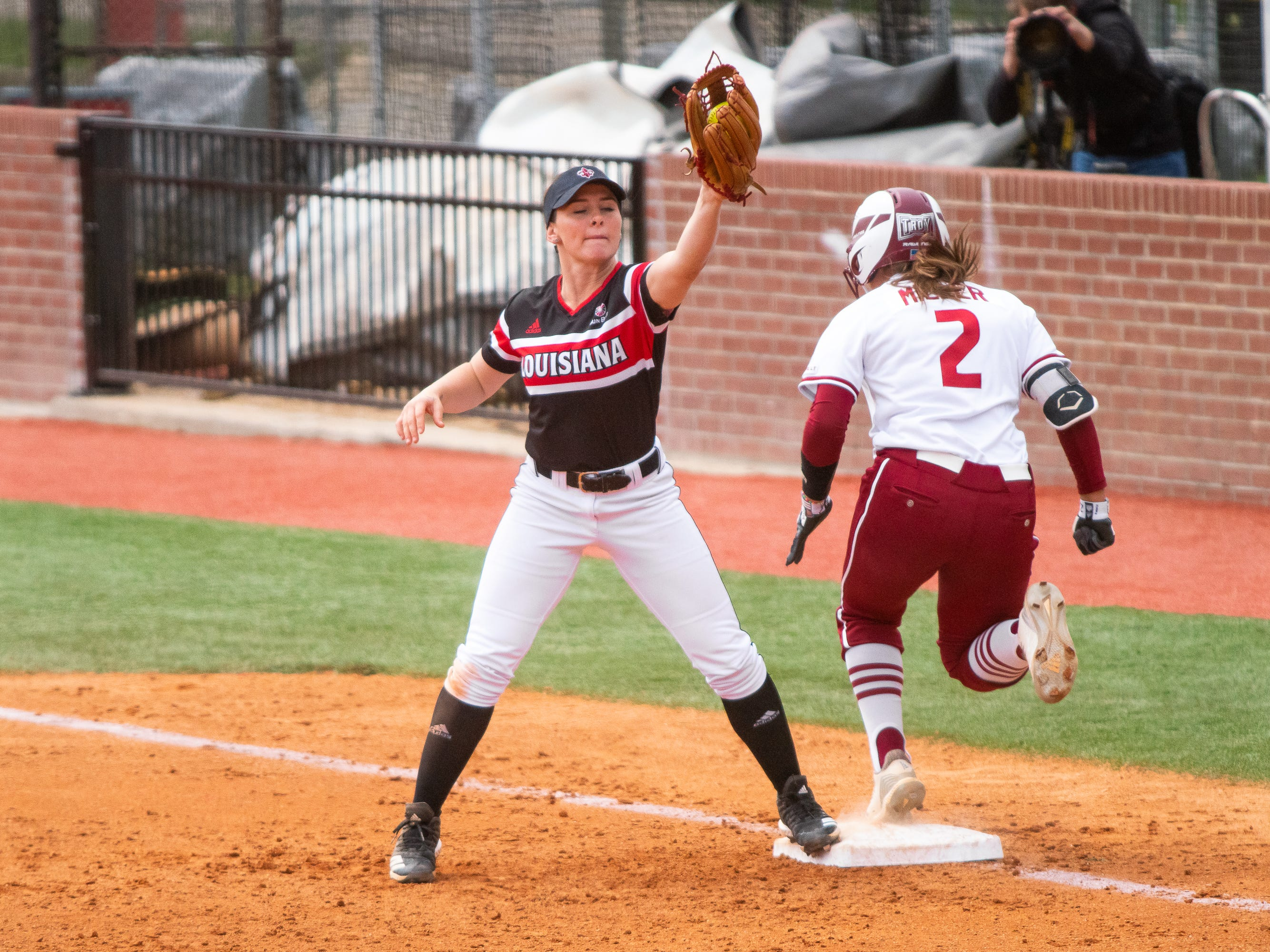 UL's Keeli Milligan makes a catch at first base to get the runner out as the Ragin' Cajuns take on the Troy Trojans at Yvette Girouard Field at Lamson Park on Saturday, March 16, 2019.