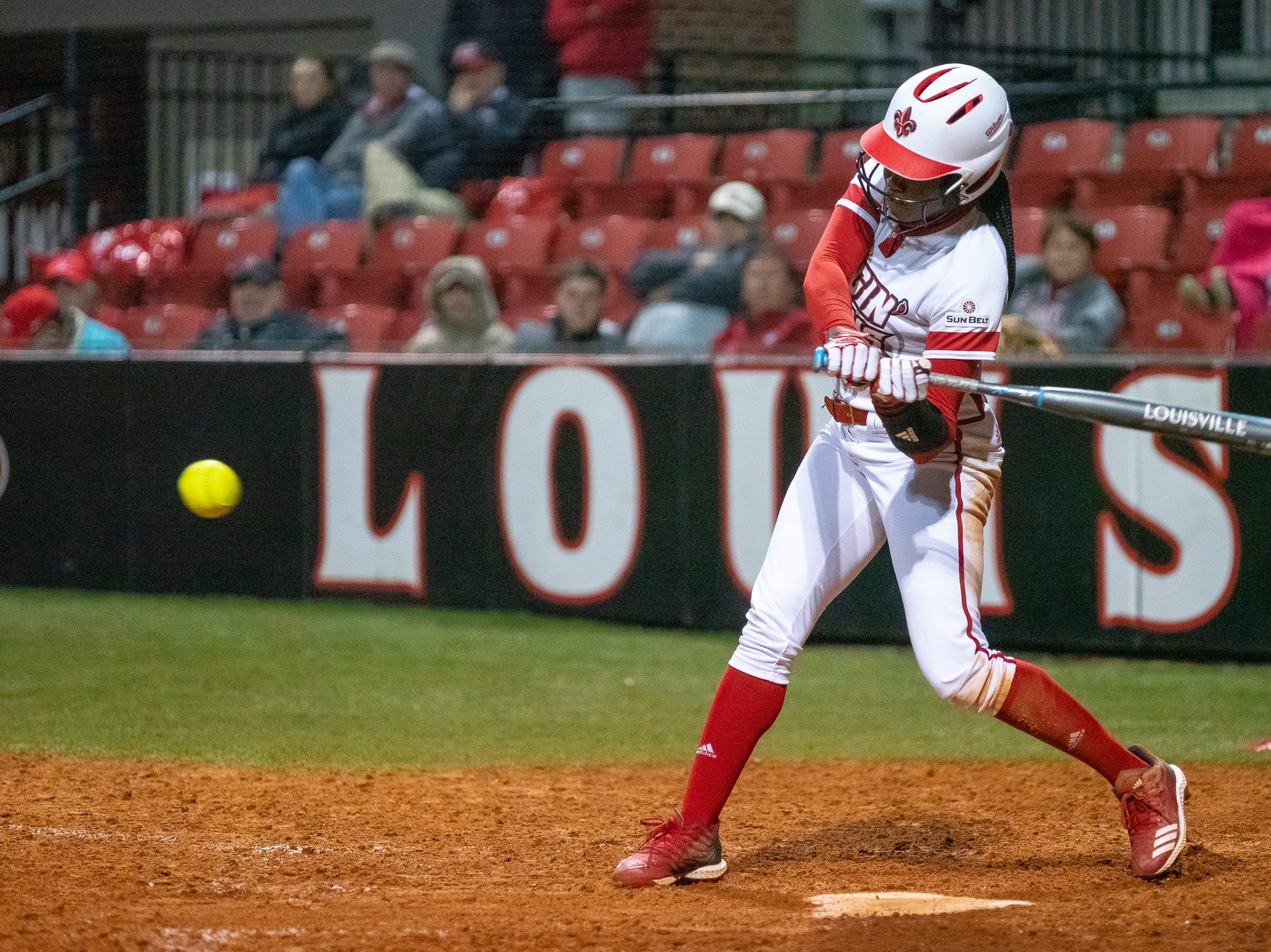 UL's Raina O'Neal swings at the incoming pitch as the Ragin' Cajuns take on the Troy Trojans at Lamson Park, Yvette Girouard Field on Friday, March 15, 2019.