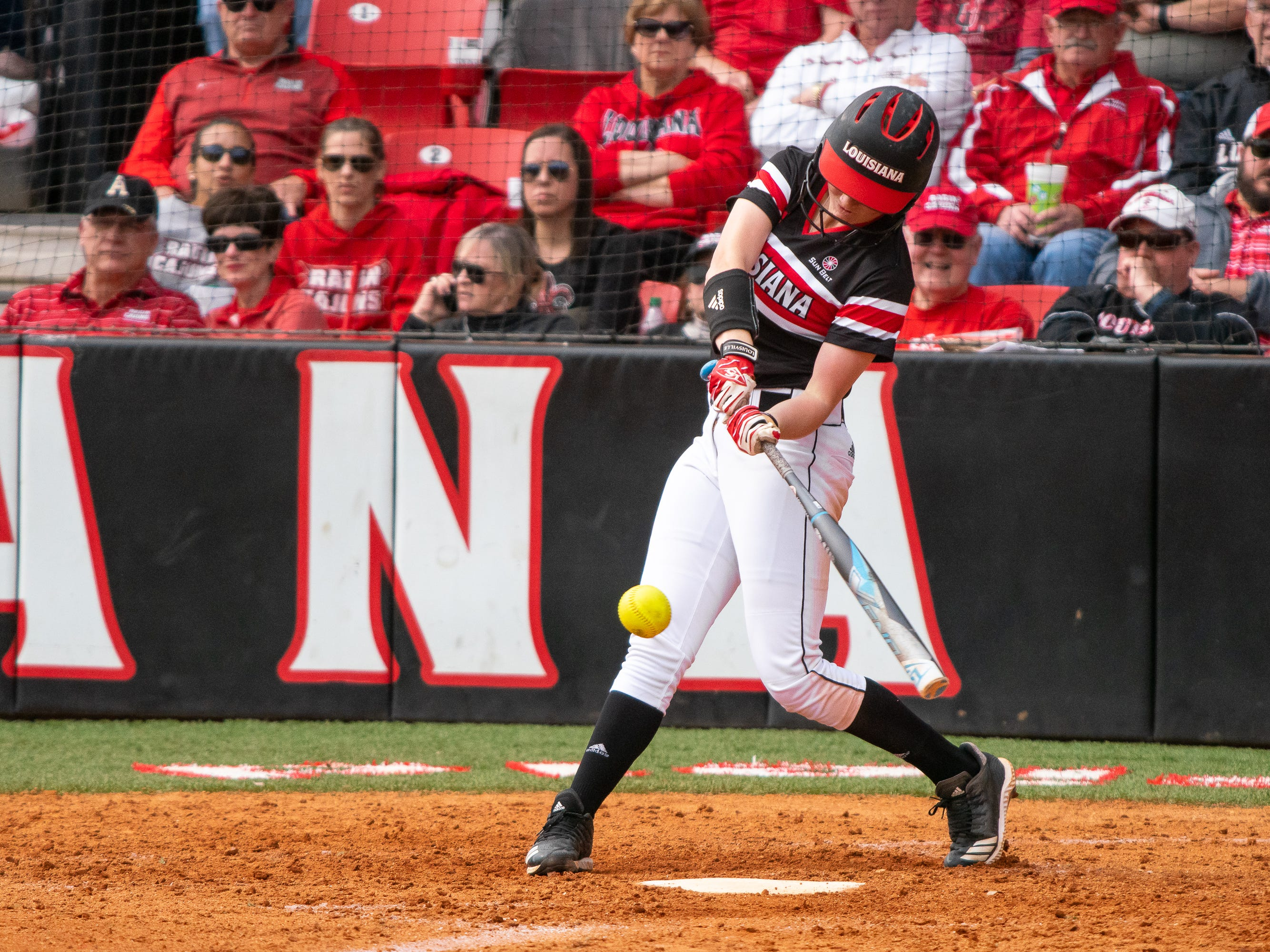 UL's Julie Rawls makes contact with the incoming ball as the Ragin' Cajuns take on the Troy Trojans at Yvette Girouard Field at Lamson Park on Saturday, March 16, 2019.