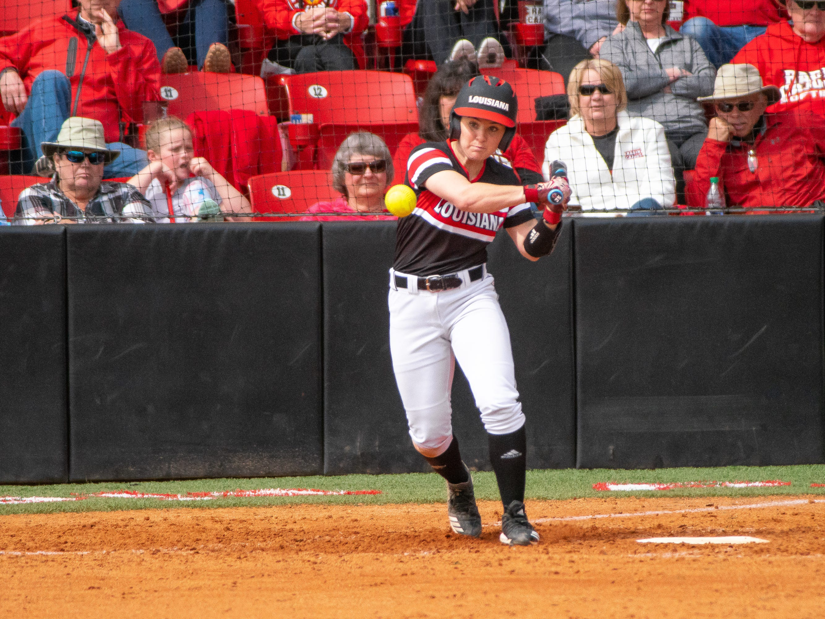 UL's Keeli Milligan swings at the pitch as the Ragin' Cajuns take on the Troy Trojans at Yvette Girouard Field at Lamson Park on Saturday, March 16, 2019.