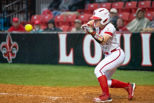 UL's Keeli Milligan bunts the ball as the Ragin' Cajuns take on the Troy Trojans at Lamson Park, Yvette Girouard Field on Friday, March 15, 2019.