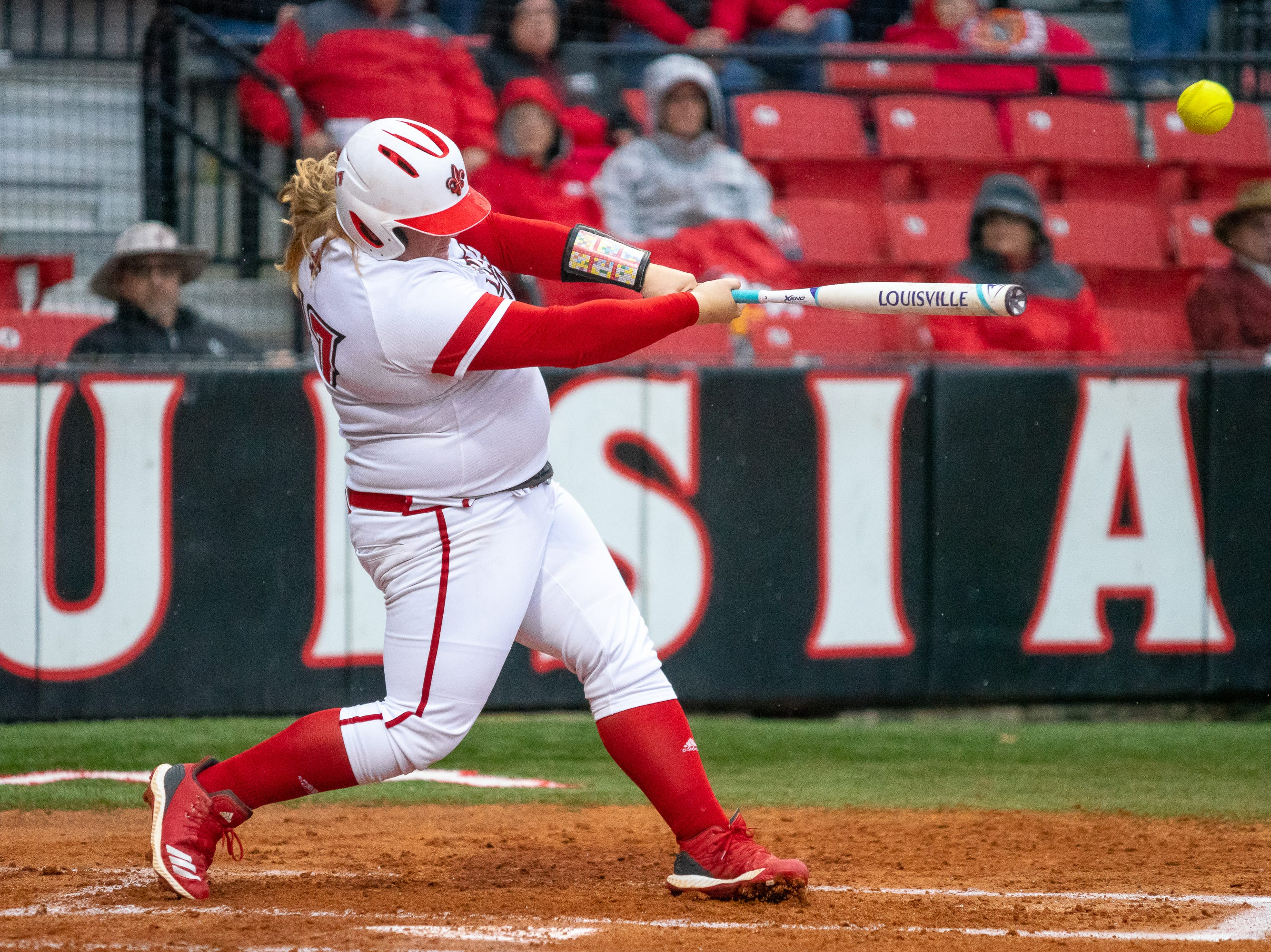 UL's Bailey Curry hits the ball high as the Ragin' Cajuns take on the Troy Trojans at Lamson Park, Yvette Girouard Field on Friday, March 15, 2019.