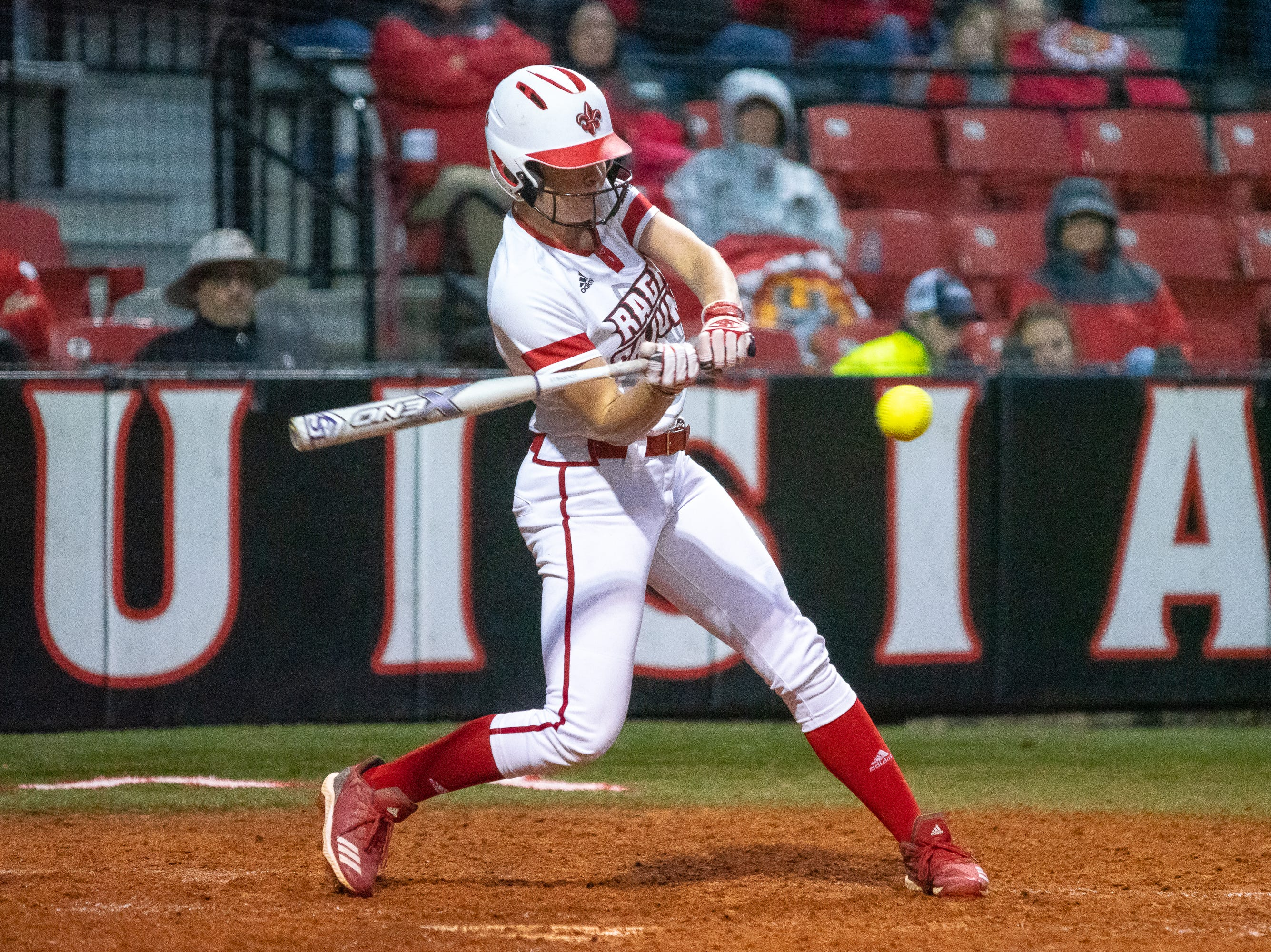 UL's Casidy Chaumont takes a swing at the ball as the Ragin' Cajuns take on the Troy Trojans at Lamson Park, Yvette Girouard Field on Friday, March 15, 2019.