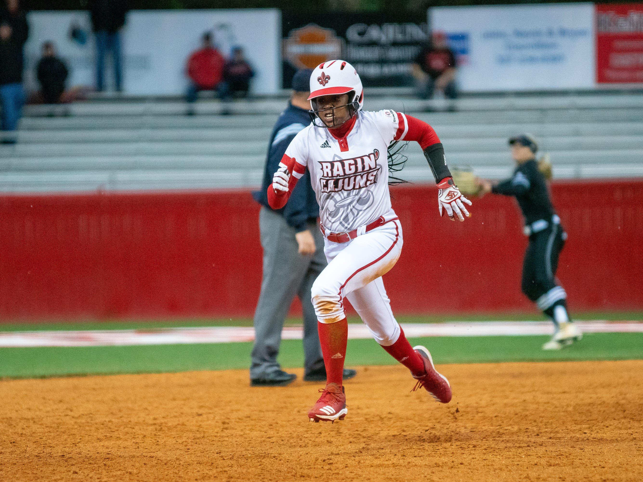 UL's Raina O'Neal sprints to third base as the Ragin' Cajuns take on the Troy Trojans at Lamson Park, Yvette Girouard Field on Friday, March 15, 2019.