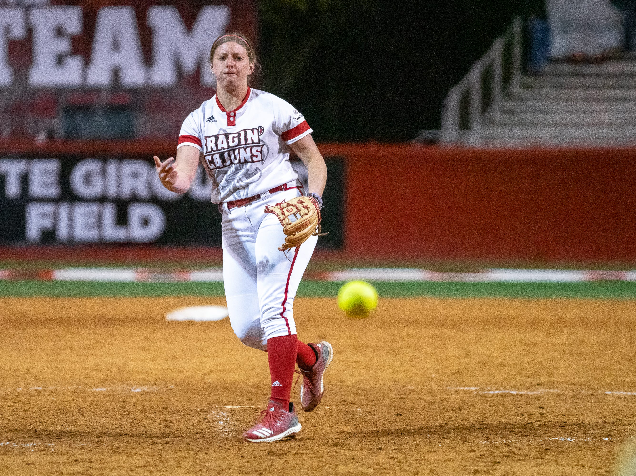 UL's pitcher Carrie Boswell throws the ball to the batter as the Ragin' Cajuns take on the Troy Trojans at Lamson Park, Yvette Girouard Field on Friday, March 15, 2019.