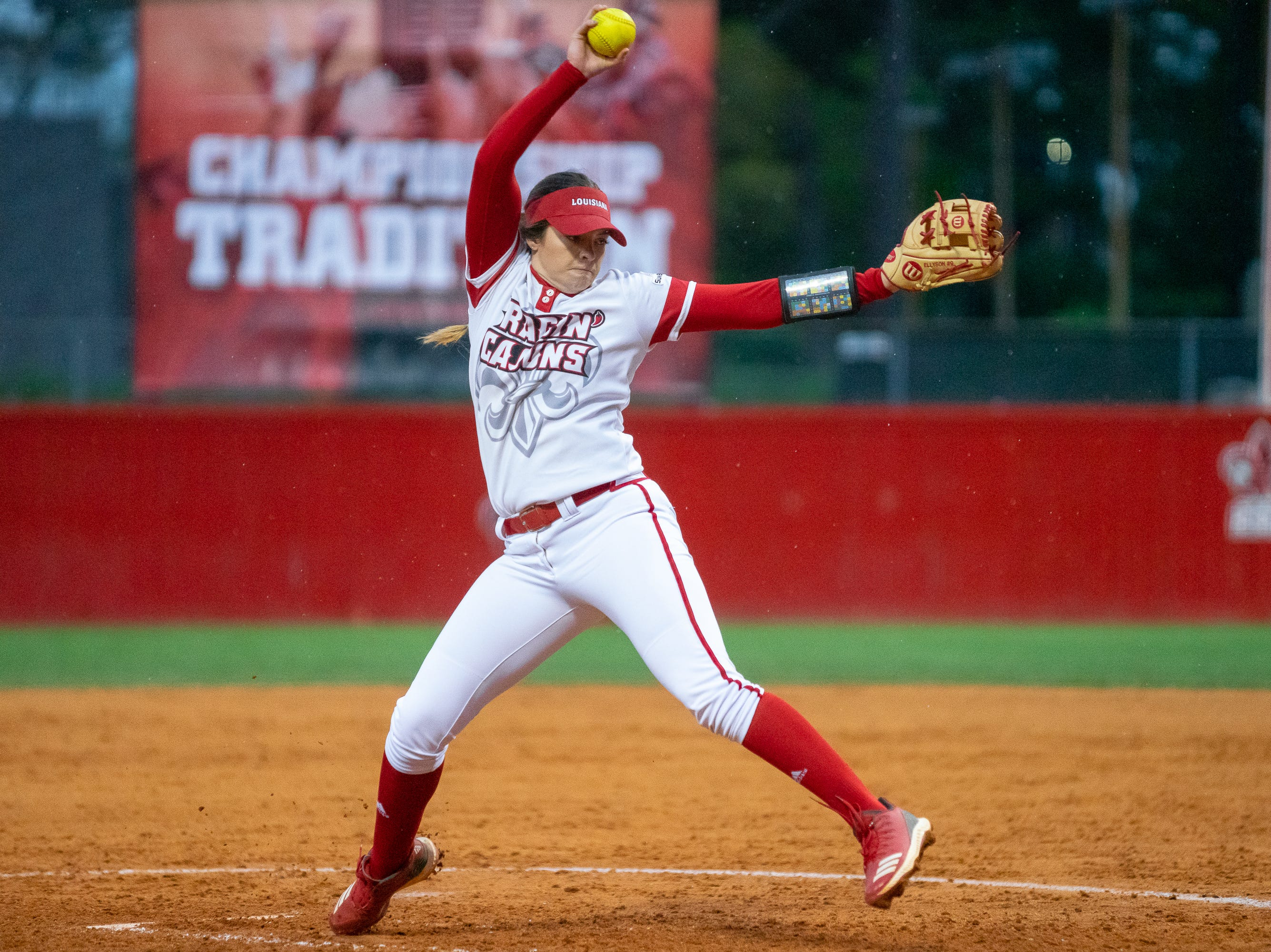 UL's pitcher Summer Ellyson throws from the circle as the Ragin' Cajuns take on the Troy Trojans at Lamson Park, Yvette Girouard Field on Friday, March 15, 2019.