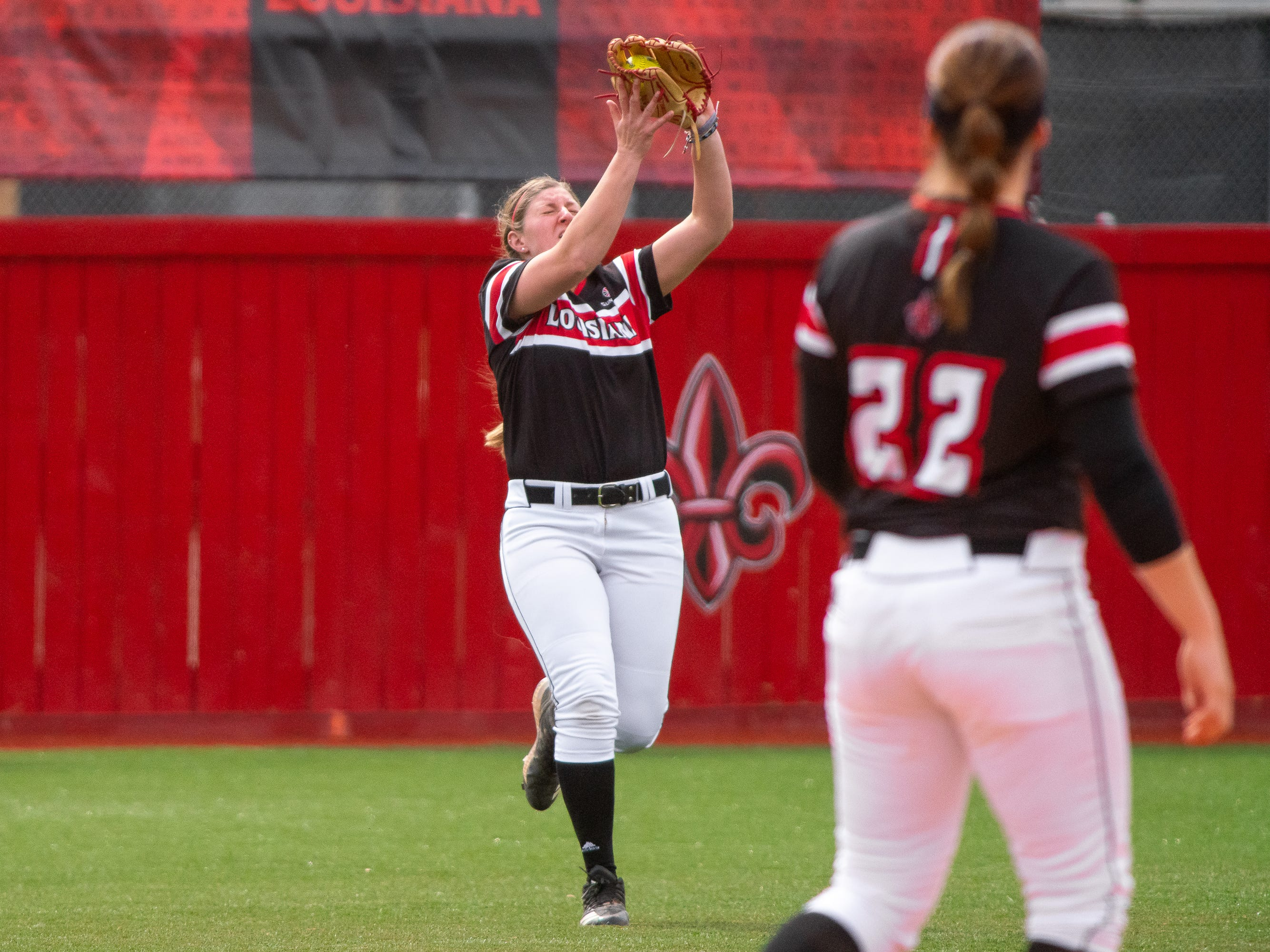 UL's Carrie Boswell makes a catch in the outfield as the Ragin' Cajuns take on the Troy Trojans at Yvette Girouard Field at Lamson Park on Saturday, March 16, 2019.