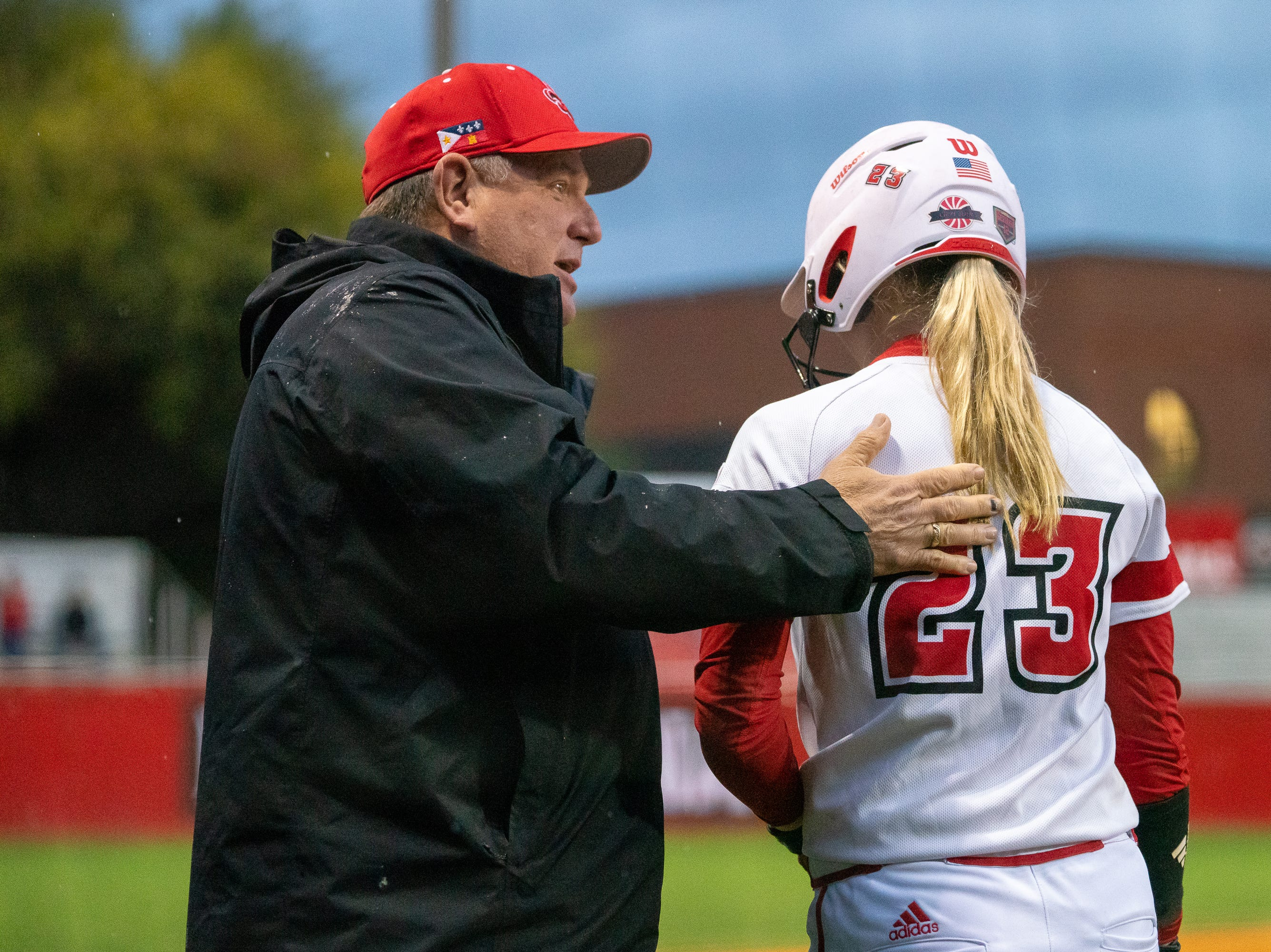 UL's head softball coach Gerry Glasco congratulates Julie Rawls after her home run as the Ragin' Cajuns take on the Troy Trojans at Lamson Park, Yvette Girouard Field on Friday, March 15, 2019.