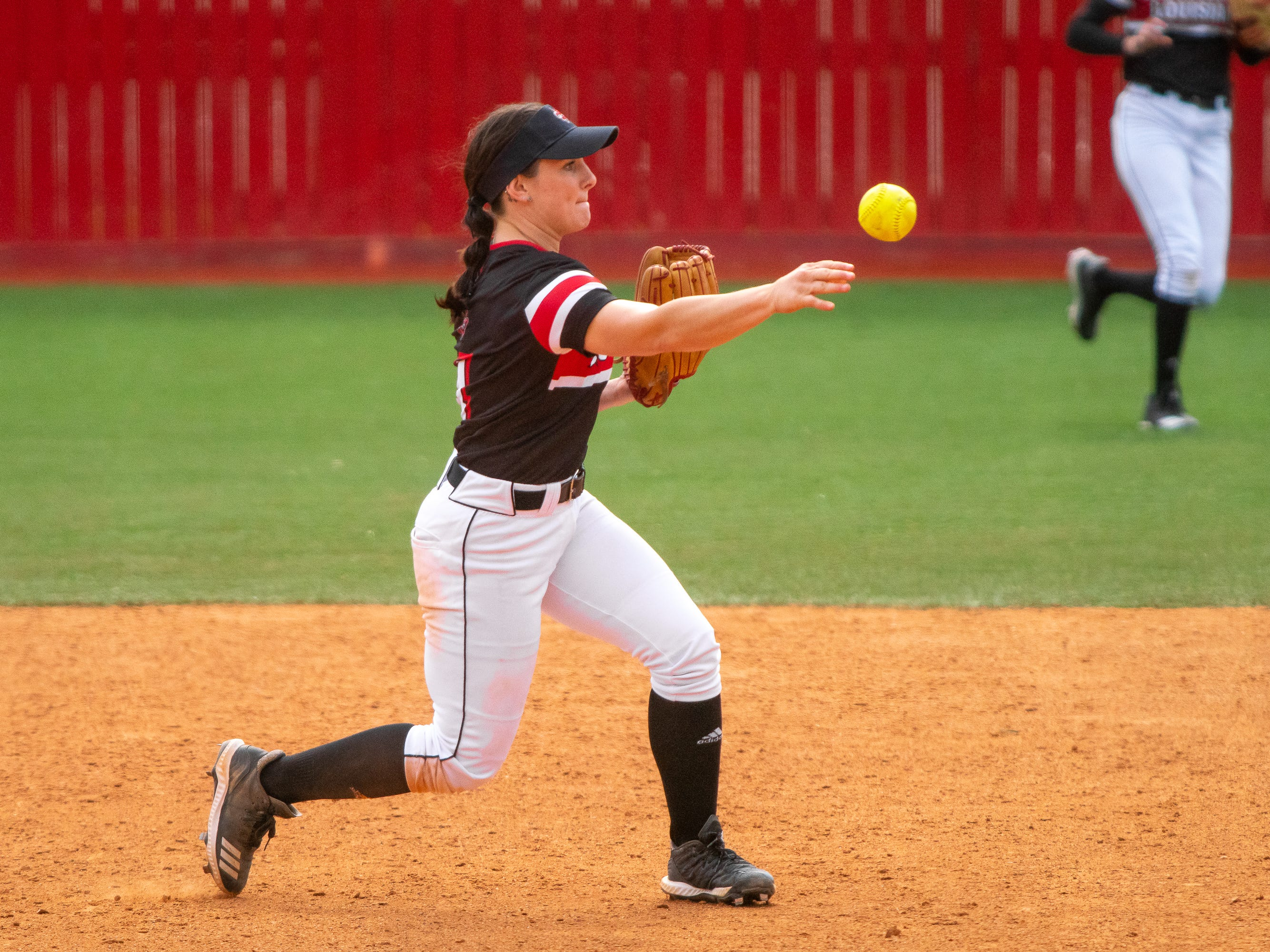 UL's Keeli Milligan throws the ball to first base as the Ragin' Cajuns take on the Troy Trojans at Yvette Girouard Field at Lamson Park on Saturday, March 16, 2019.