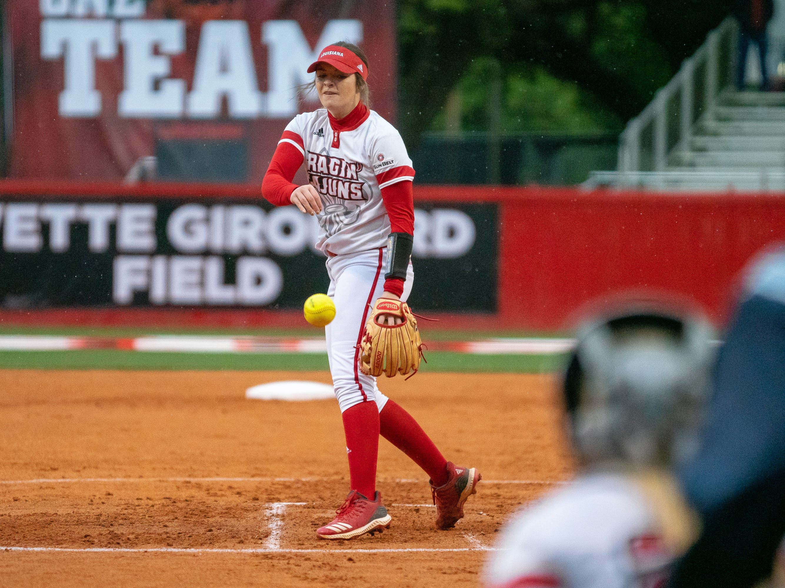 UL's Summer Ellyson throws a pitch to the batter as the Ragin' Cajuns take on the Troy Trojans at Lamson Park, Yvette Girouard Field on Friday, March 15, 2019.