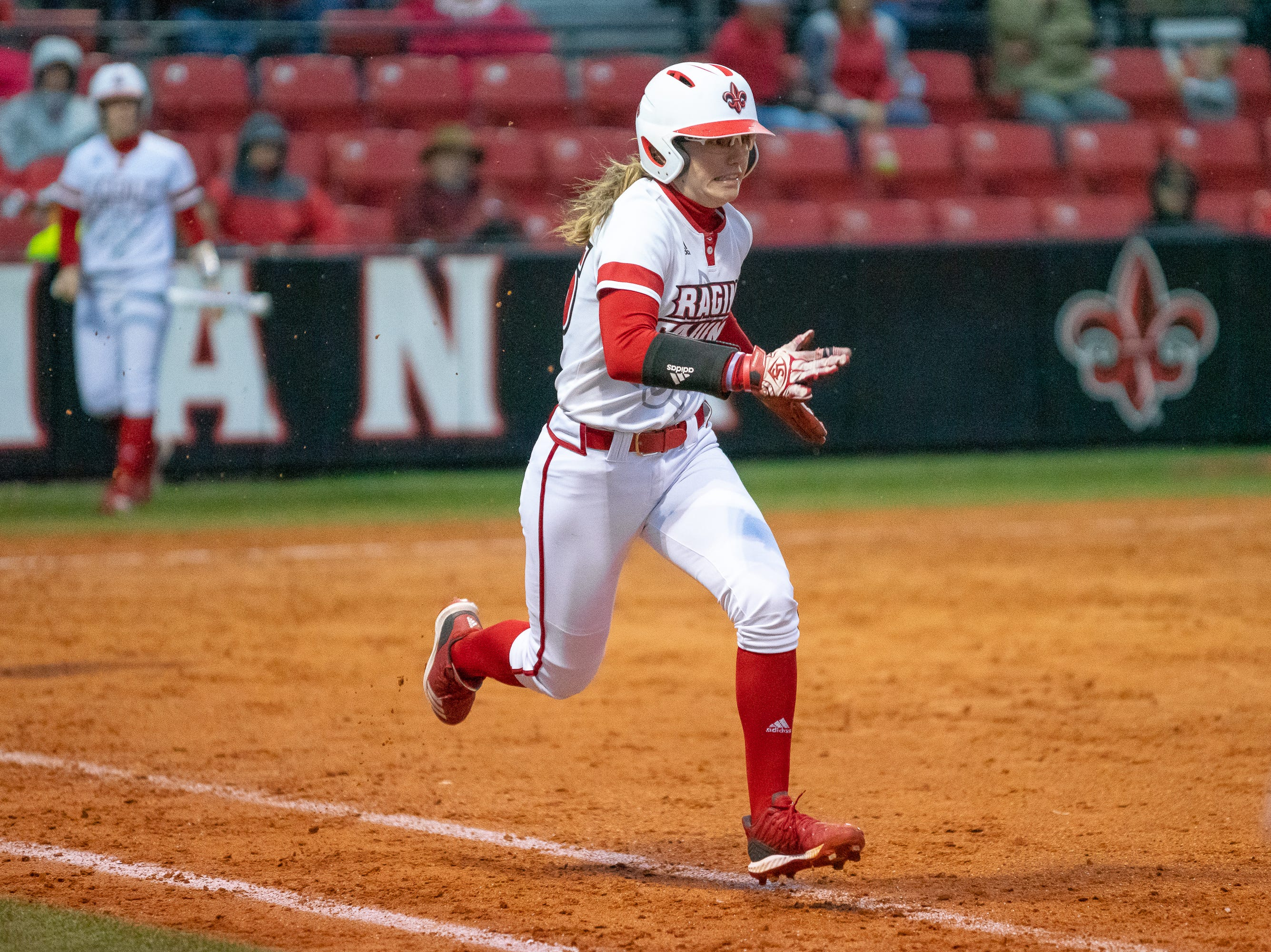 UL's Sarah Hudek runs to first base as the Ragin' Cajuns take on the Troy Trojans at Lamson Park, Yvette Girouard Field on Friday, March 15, 2019.