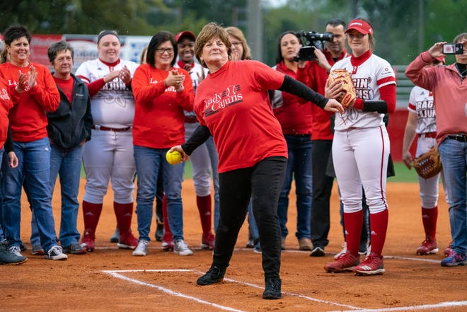 Former UL softball coach Yvette Girouard throws out the first pitch as the Ragin' Cajuns take on the Troy Trojans at Lamson Park, Yvette Girouard Field on Friday, March 15, 2019.
